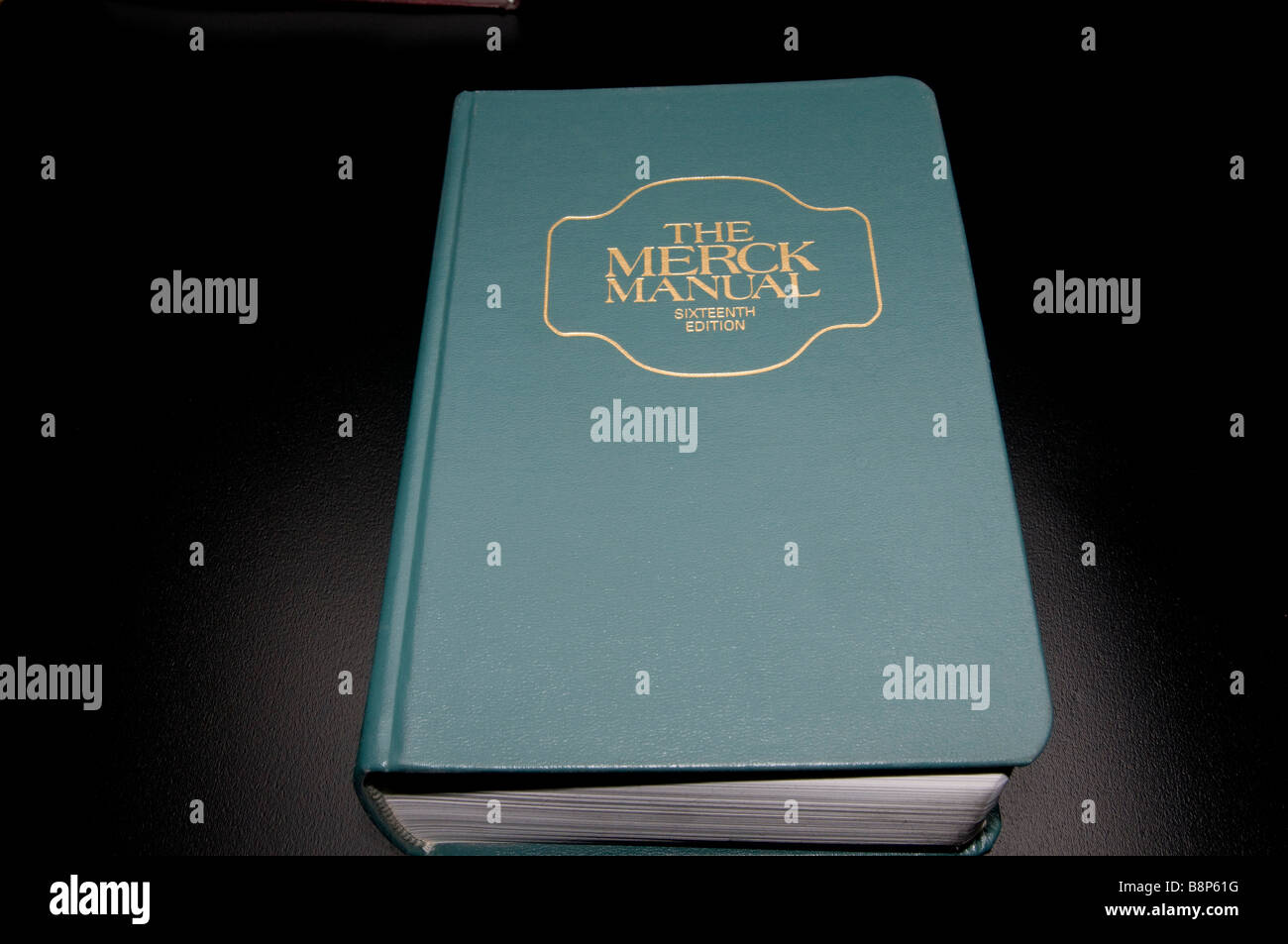 The Merck Manual of Diagnosis and Therapy on black background - Stock Image