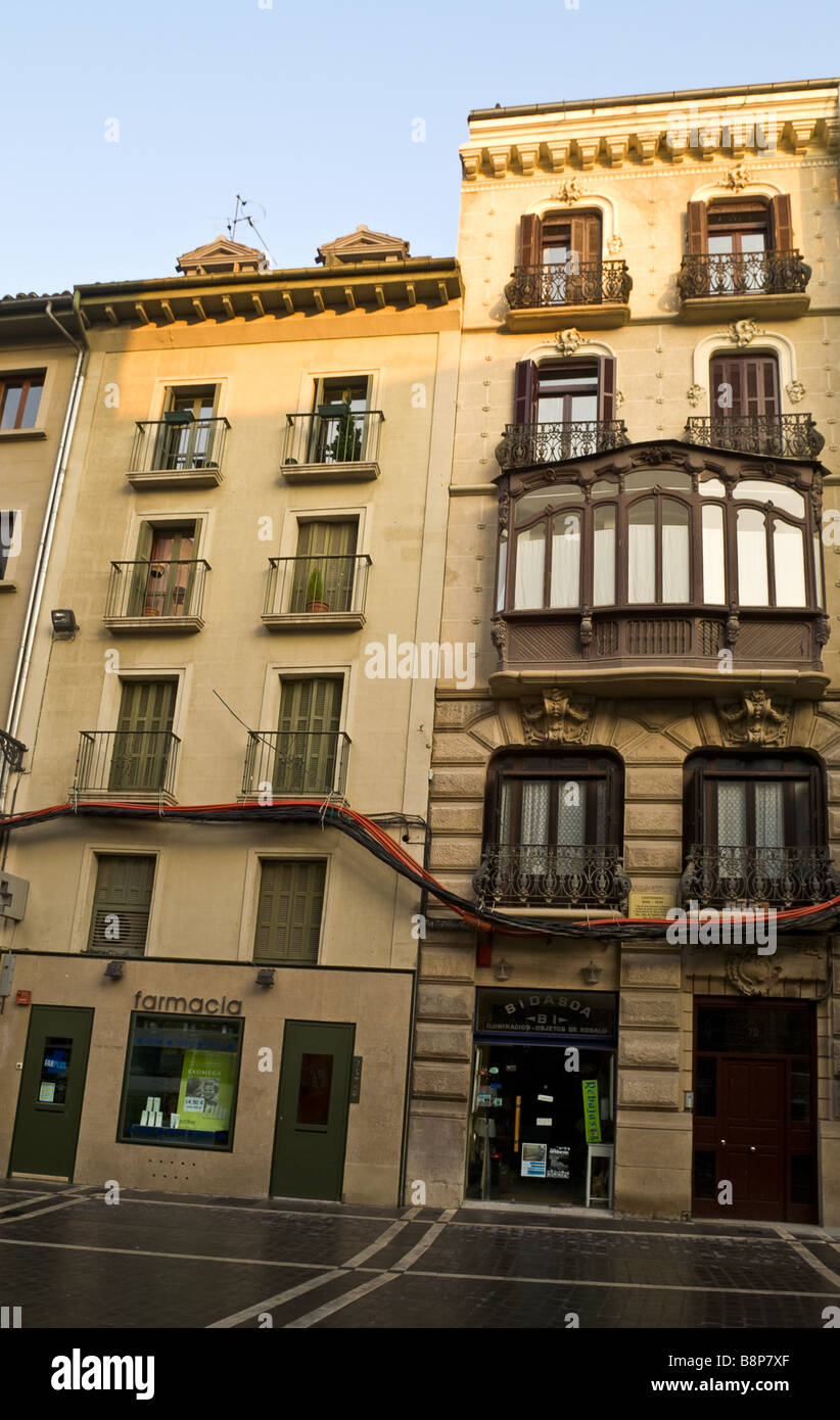 Facade of a house in Pamplona with a bunch of electric cables on it Stock Photo