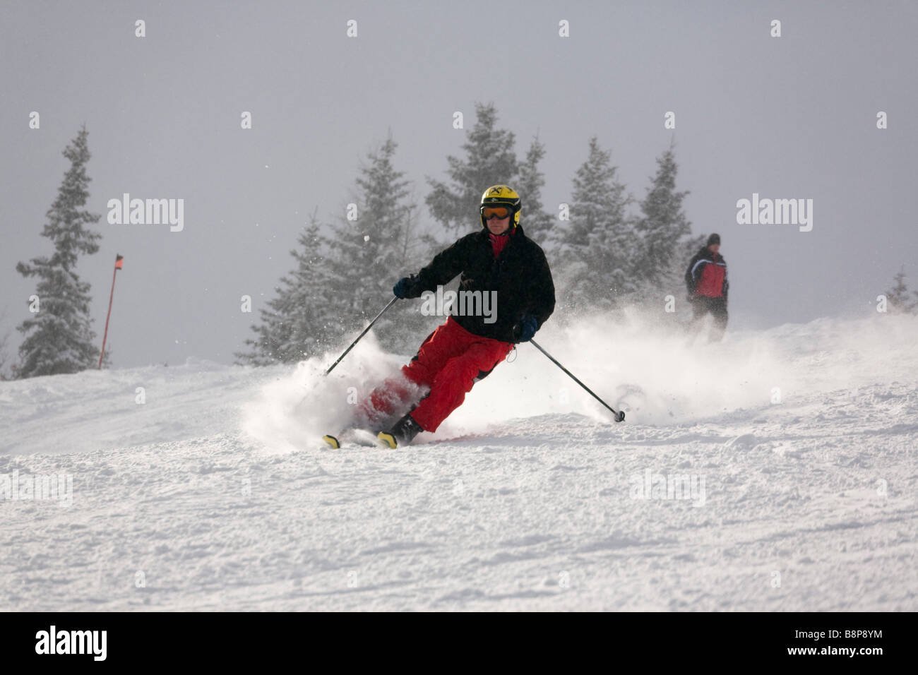 Austria Europe Skier skiing downhill with fresh snowfall on ski slope piste in Austrian Alps in winter snow Stock Photo