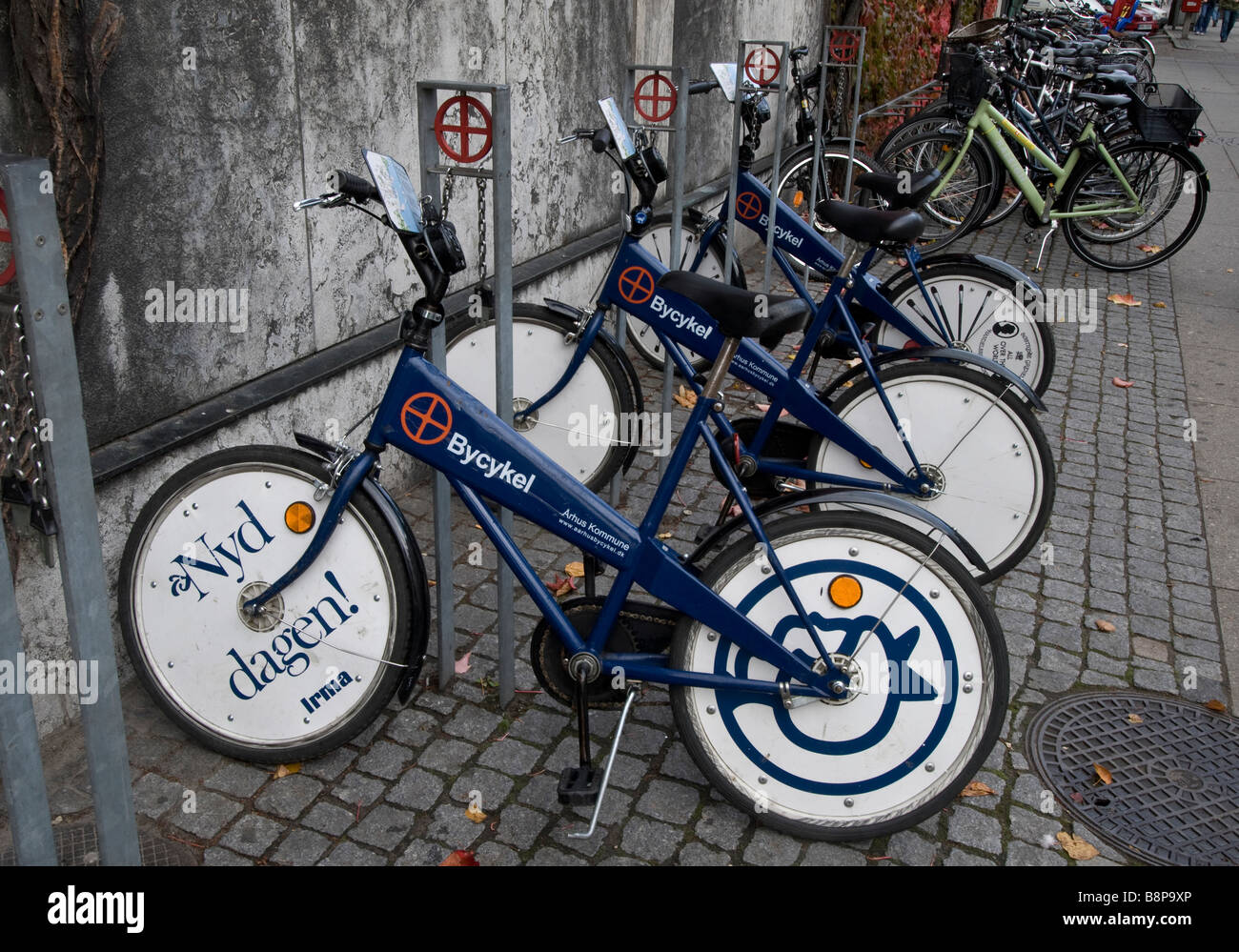 Arhus city bicycles chained and parked for use by citizens as a temporary usage rental scheme, Denmark - Stock Image