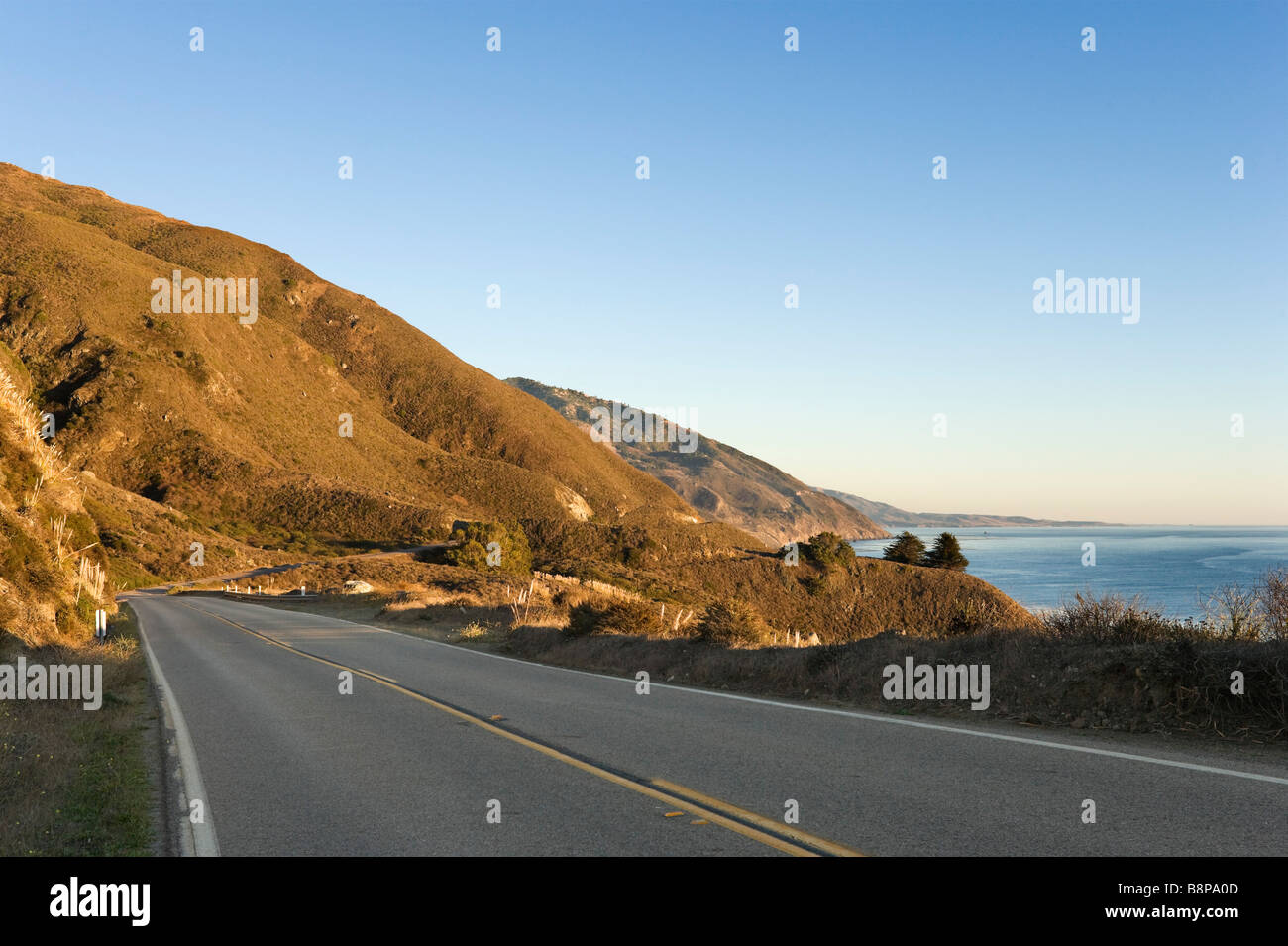 Coastline just before sunset, Pacific Coast Highway (Highway 1) near Gorda, Big Sur Coast, Central California, USA - Stock Image