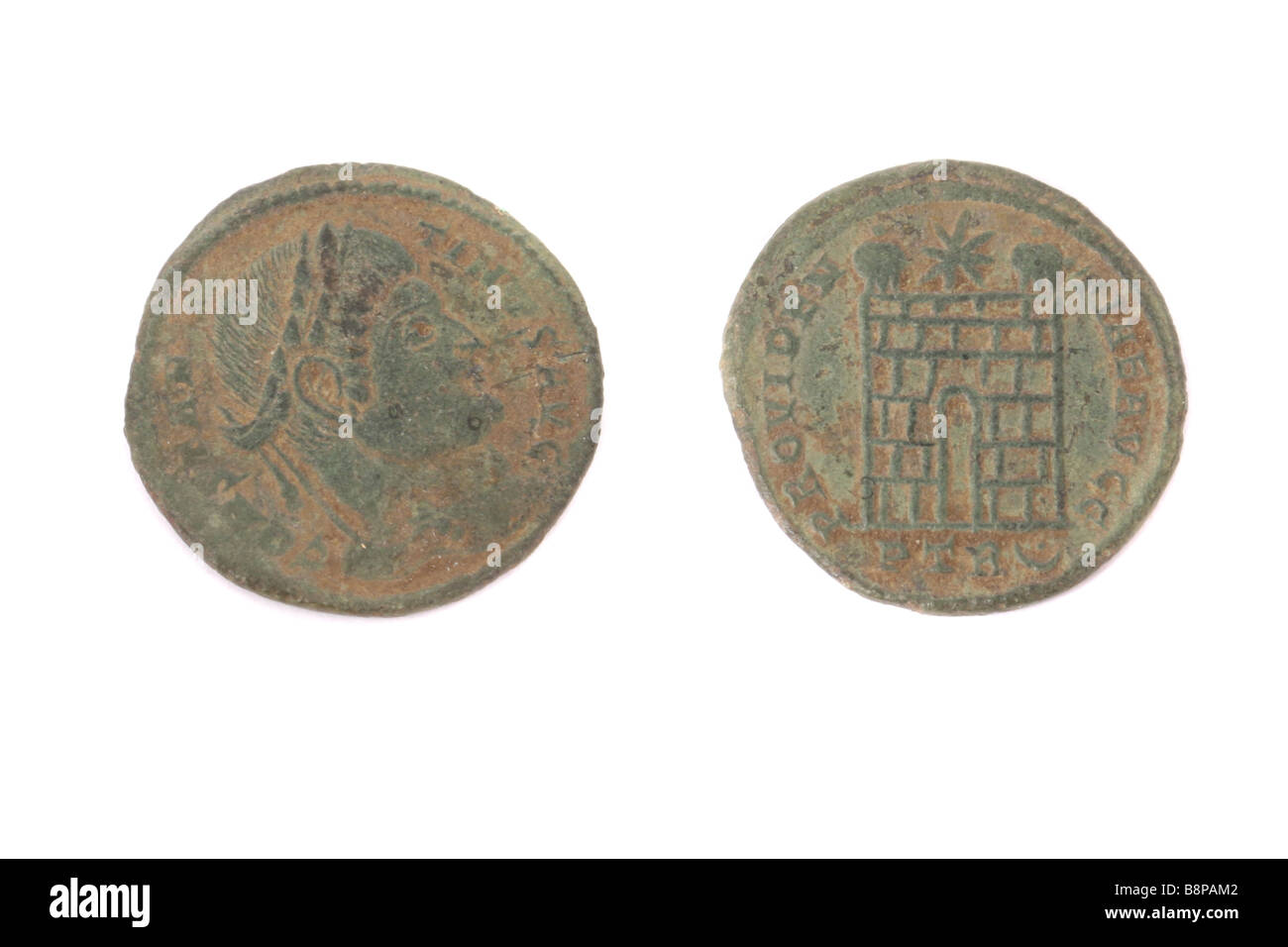 The front and back of a Roman coin found in England. - Stock Image