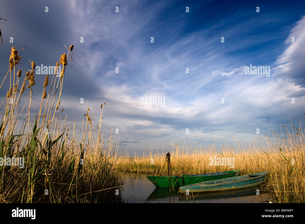 Two tied up boats on a warm afternoon, Delta de l'Ebre natural reserve, Spain Stock Photo