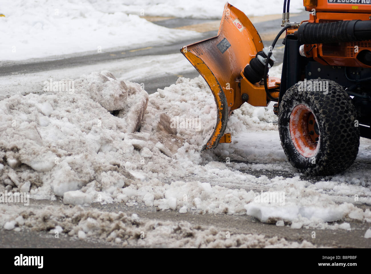 Snow plow clearing the streets after a heavy snow fall Neuchatel Switzerland - Stock Image