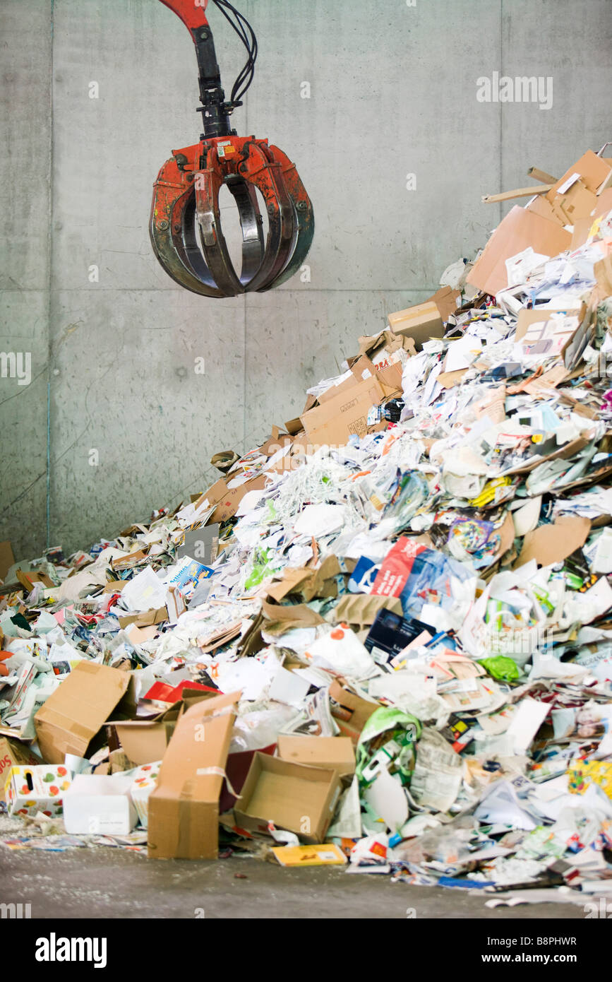 Waste paper being processed in recycling center - Stock Image