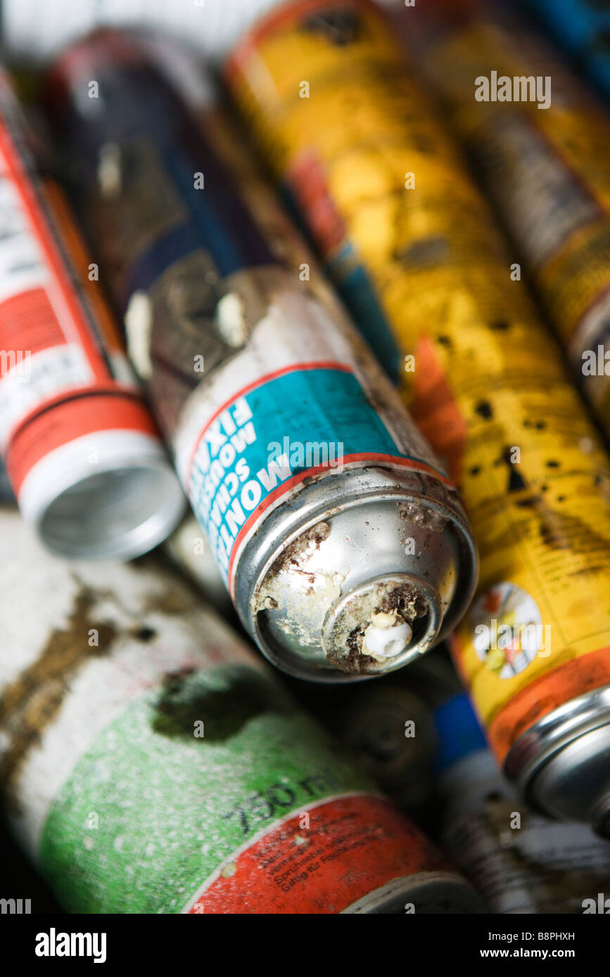 Discarded aerosol cans, close-up - Stock Image