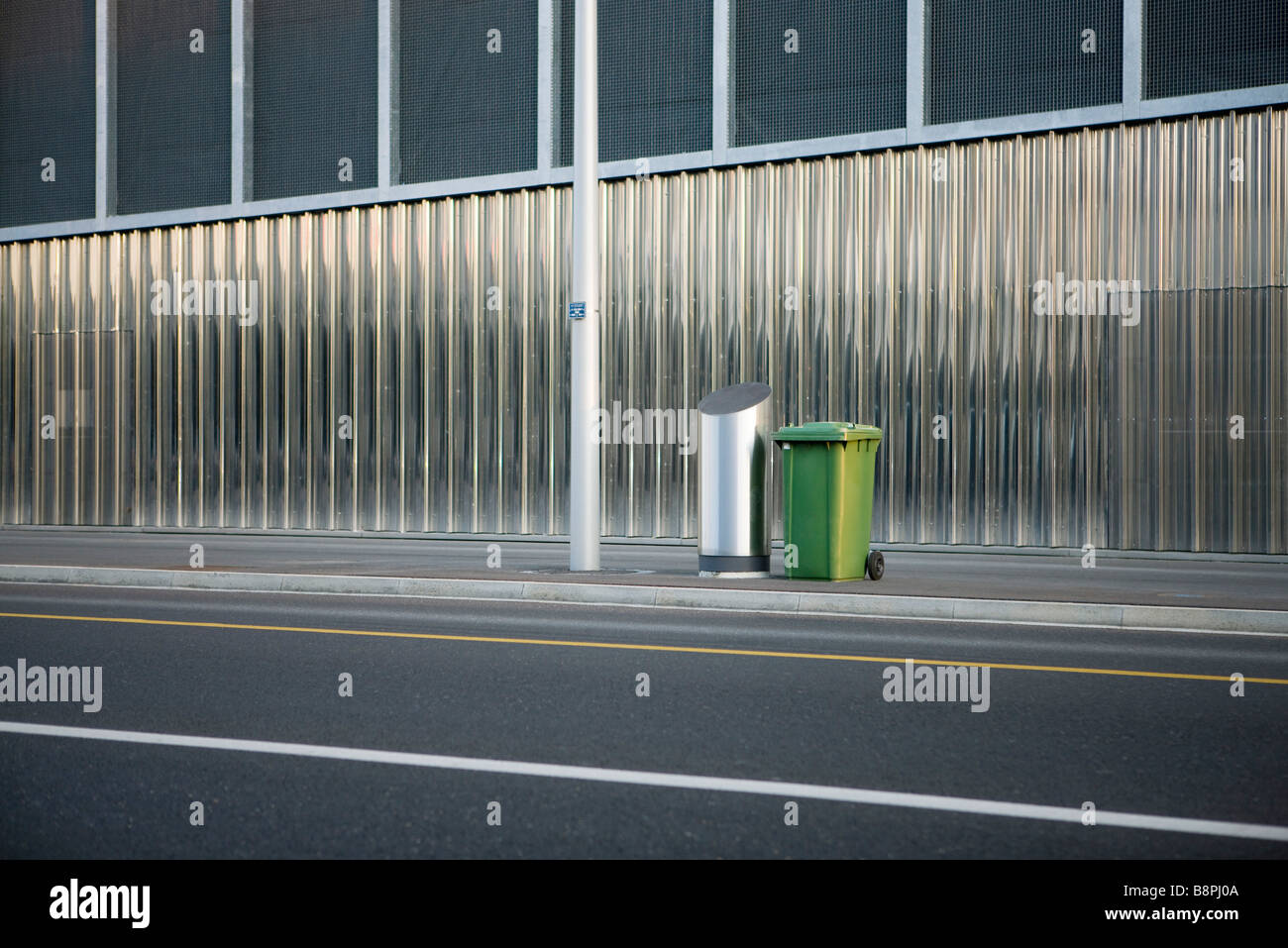 Trash cans on sidewalk - Stock Image