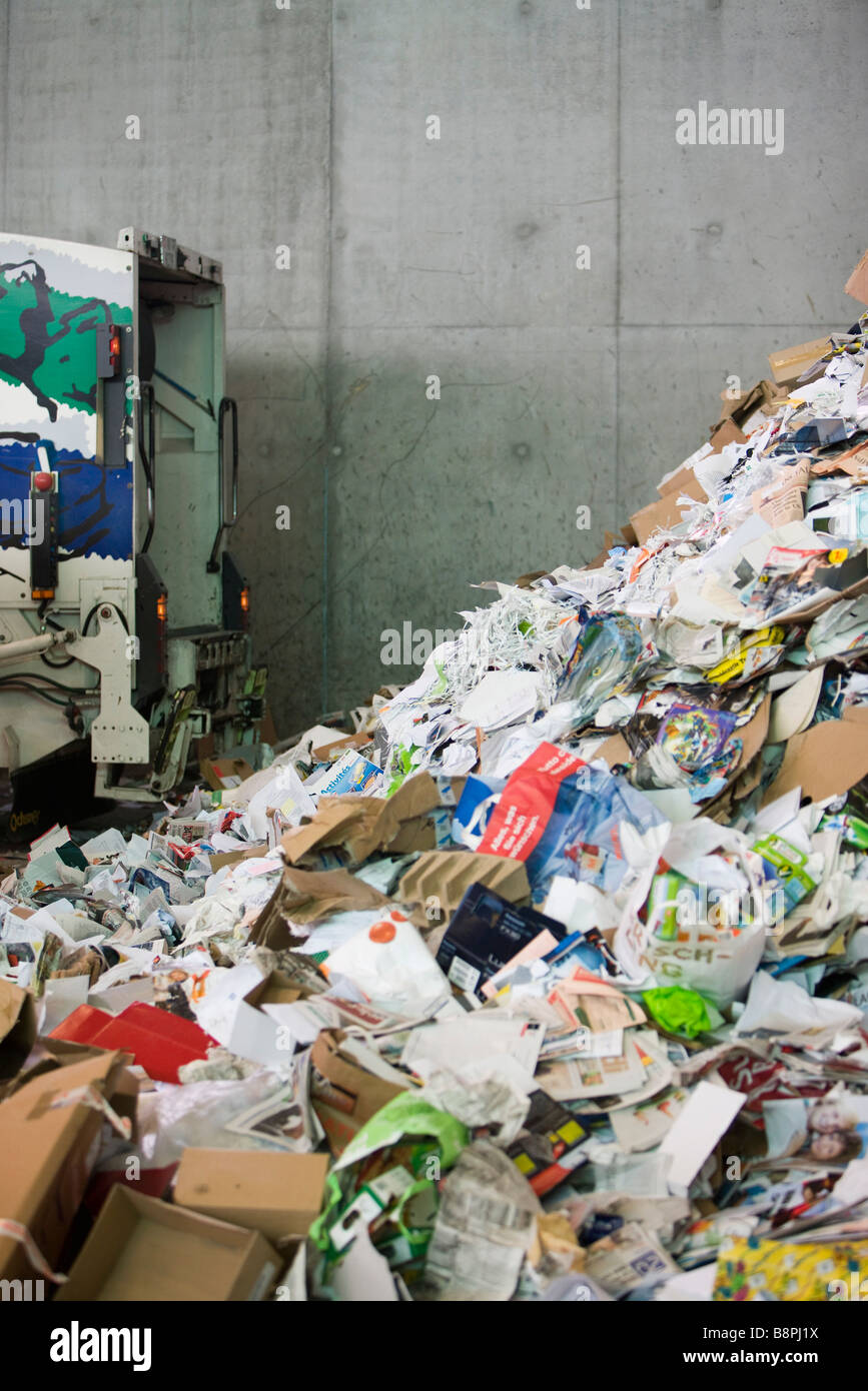 Truck dumping paper in recycling center - Stock Image