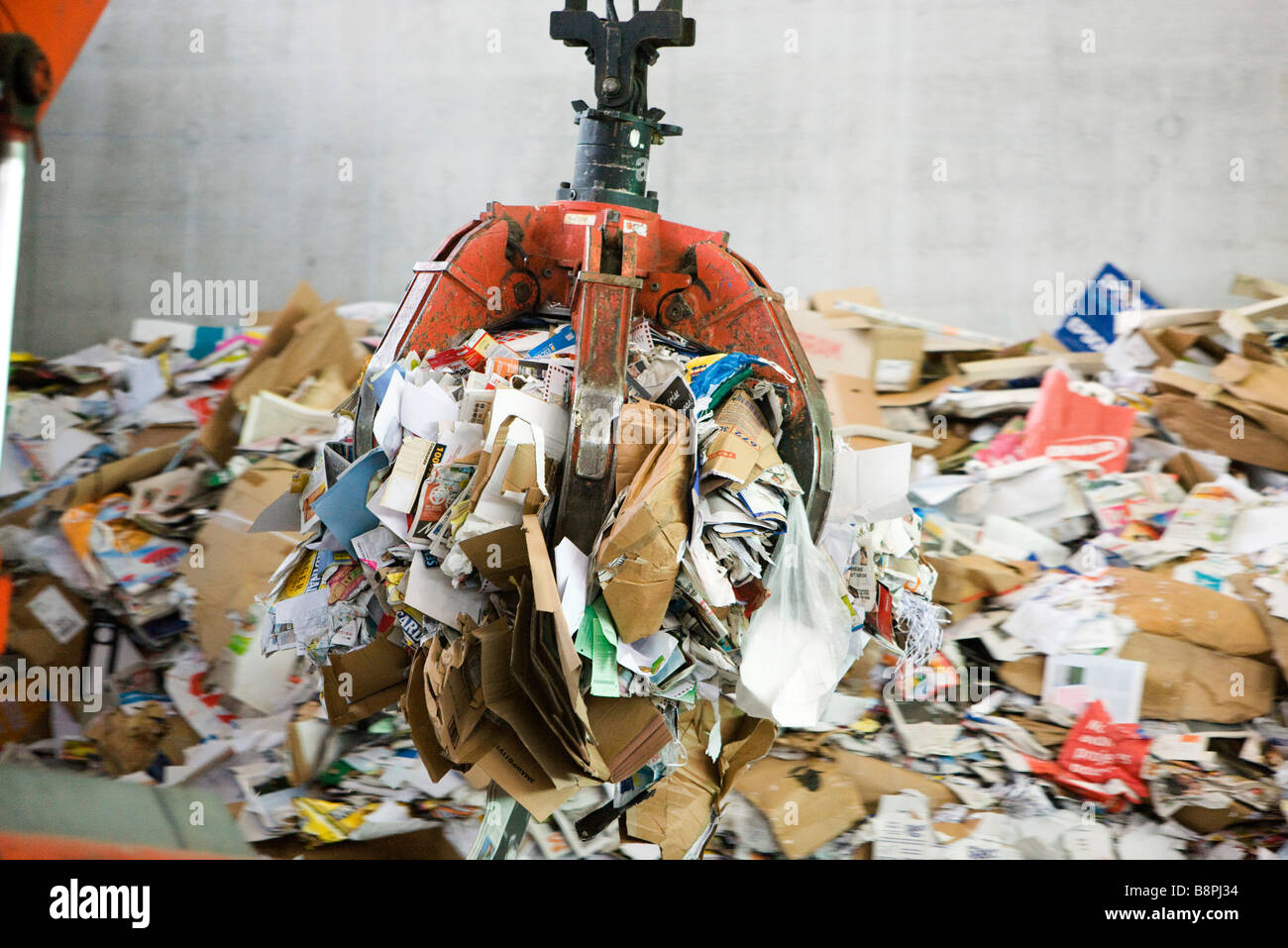 Waste paper being processed in recycling center Stock Photo