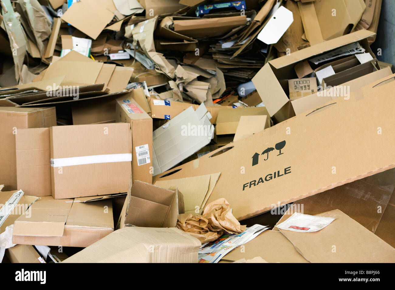Heap of flattened cardboard boxes - Stock Image