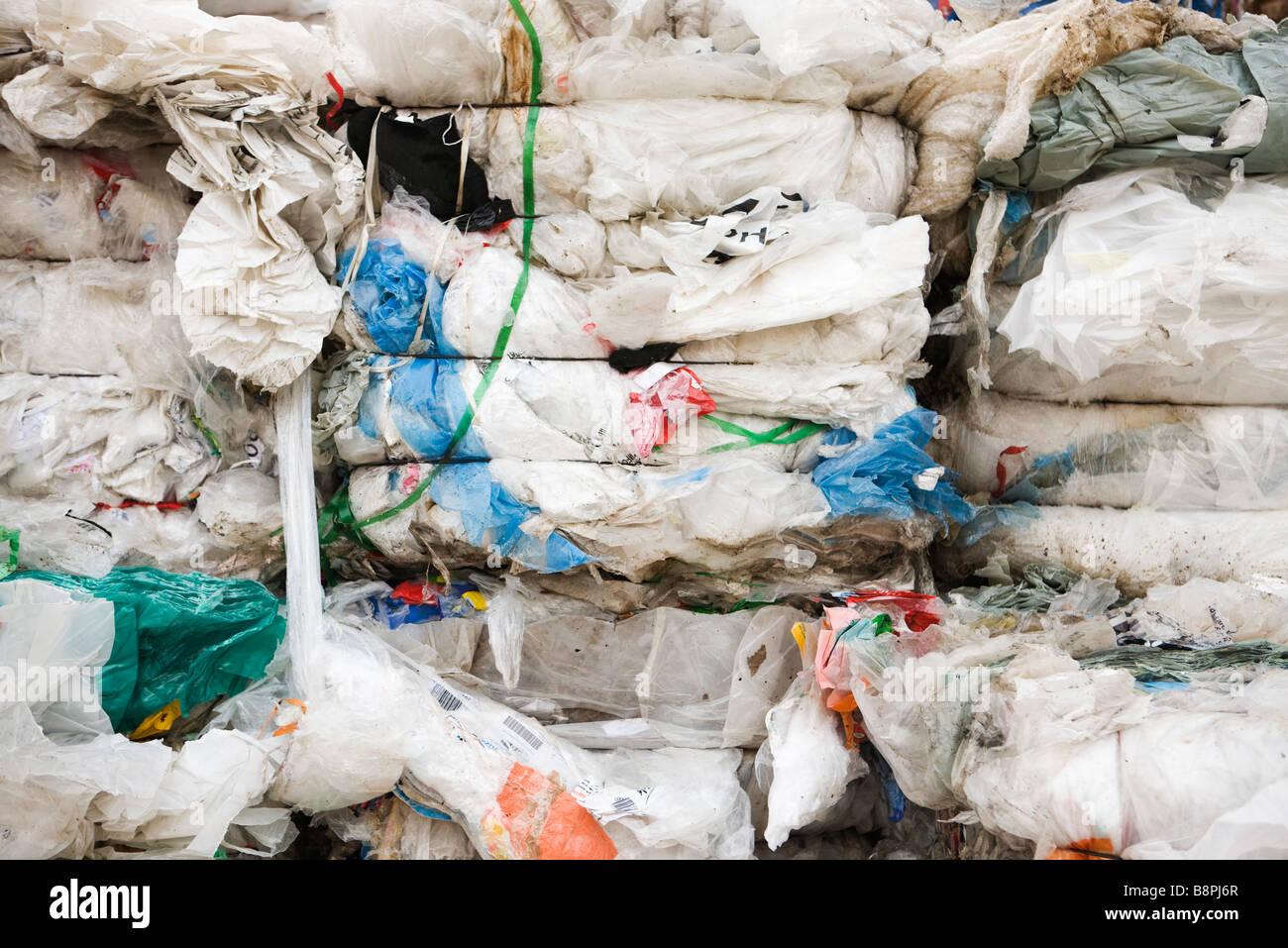 Bales of flattened plastic, full frame - Stock Image