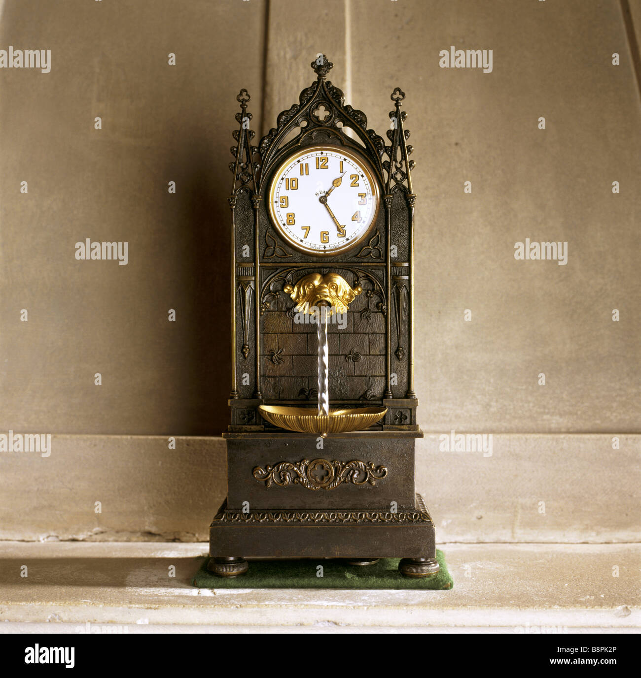 Close up of the Swiss Gothic fountain clock in the Prior s room at Anglesey Abbey - Stock Image