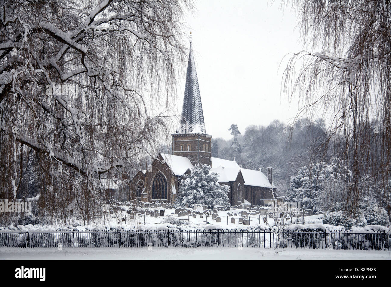 St Peter and St Paul Church, Godalming, Surrey in the snow - Stock Image