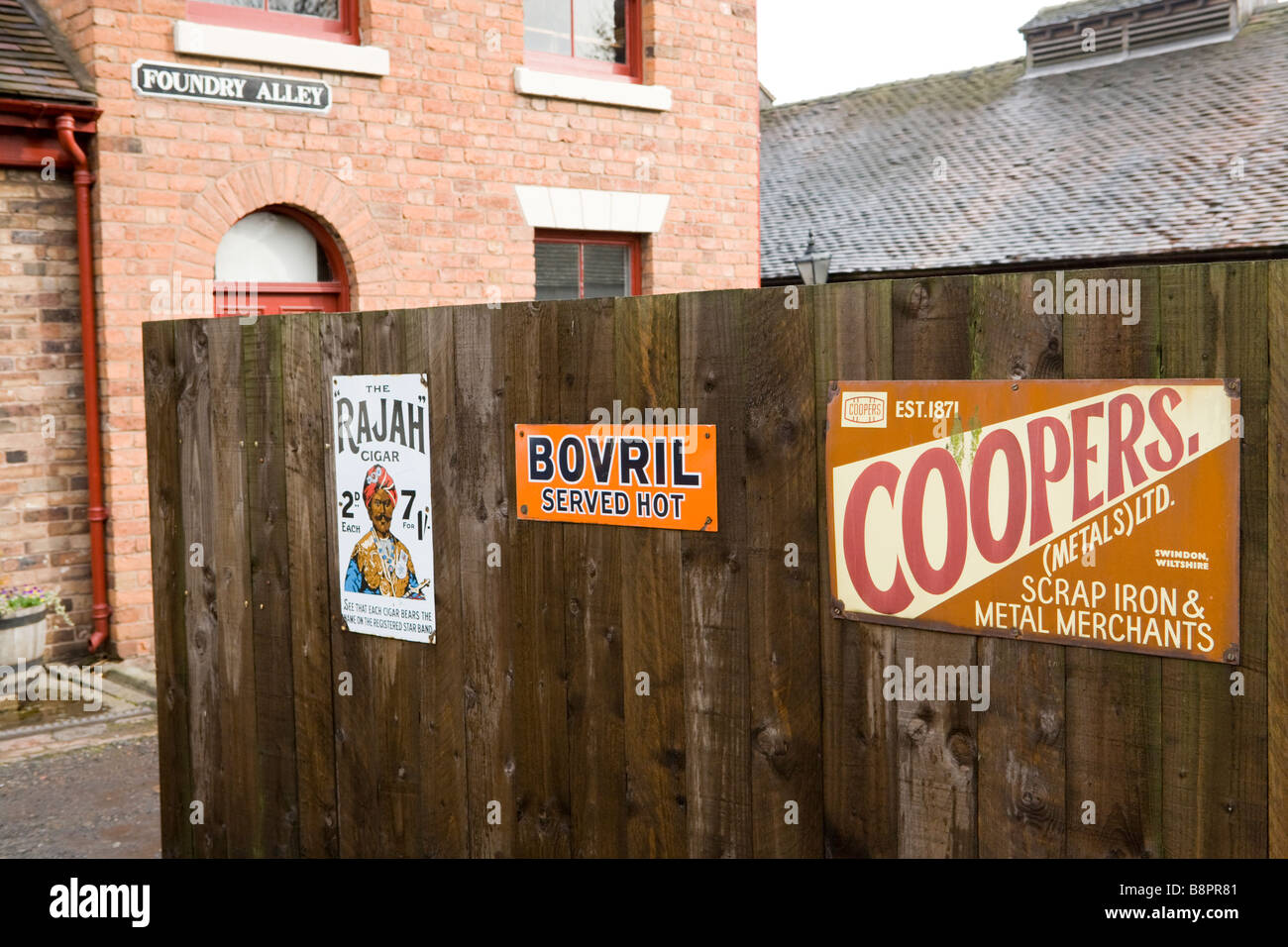 Old advertisements at Blists Hill Victorian Town open air museum at Ironbridge, Shropshire - Stock Image