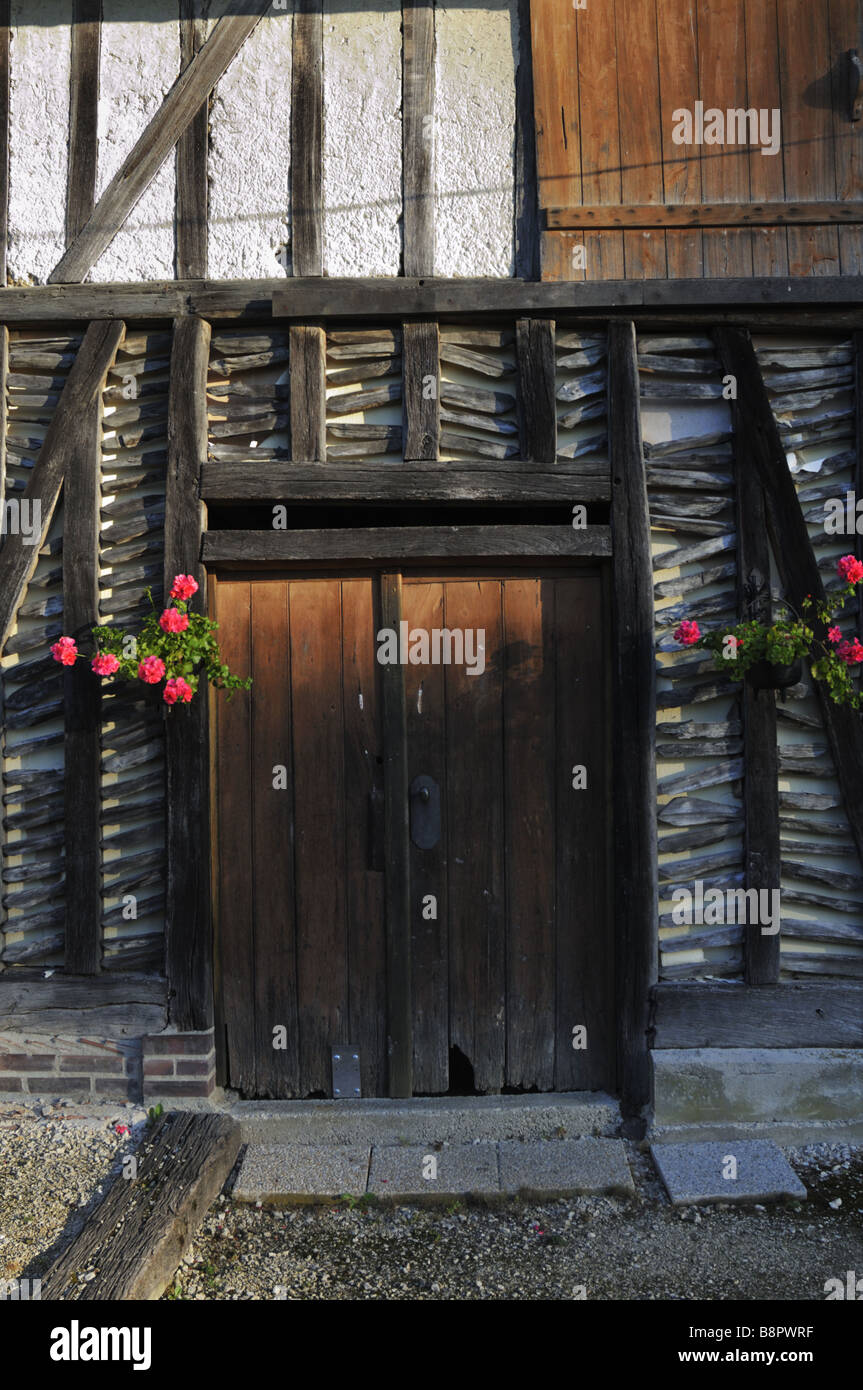 Exposed wall timber frames of an old French farmhouse Stock Photo