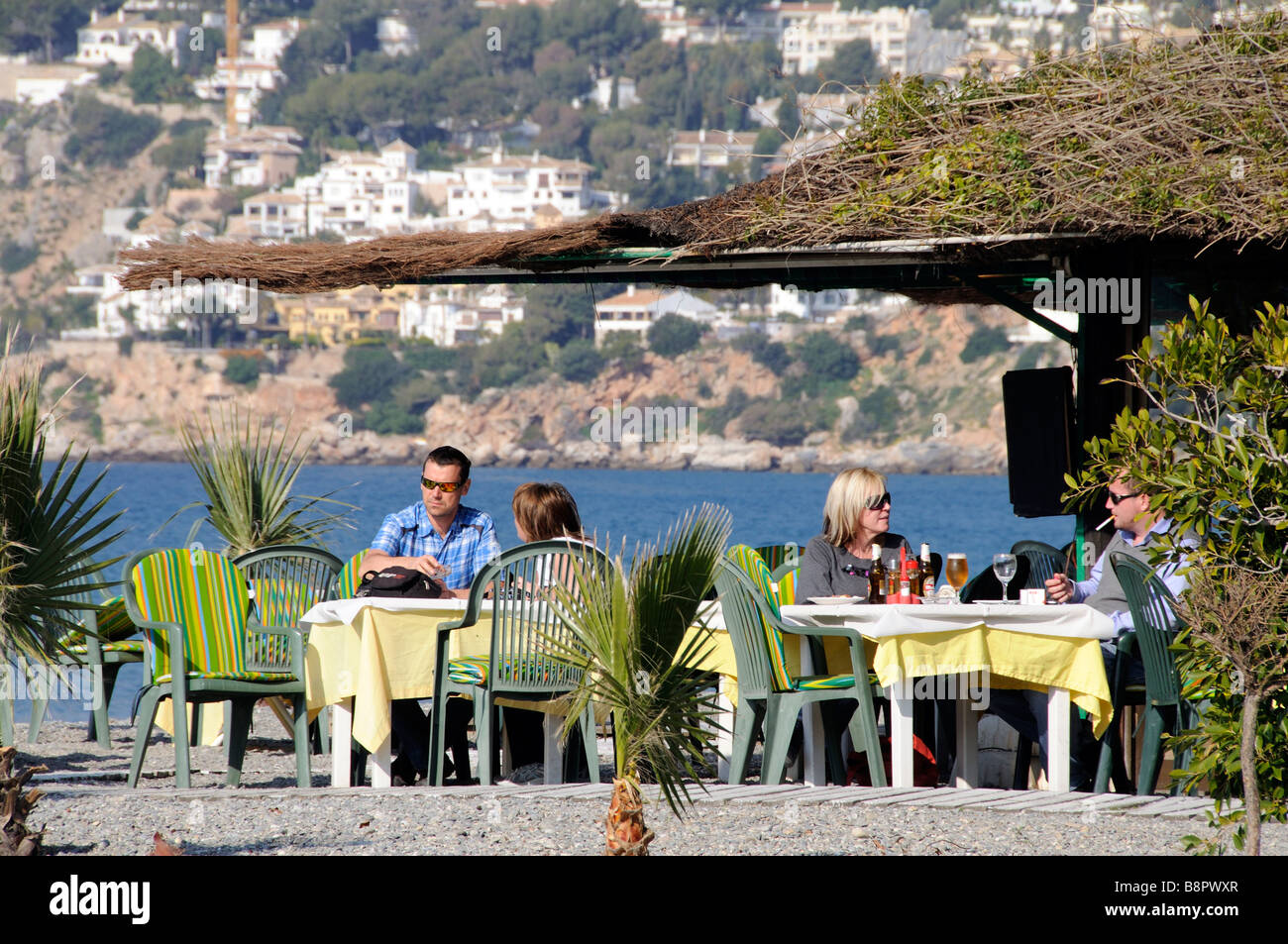 Beach Cafe Bar And Customers At La Herradura On The Costa Tropical Stock Photo Alamy