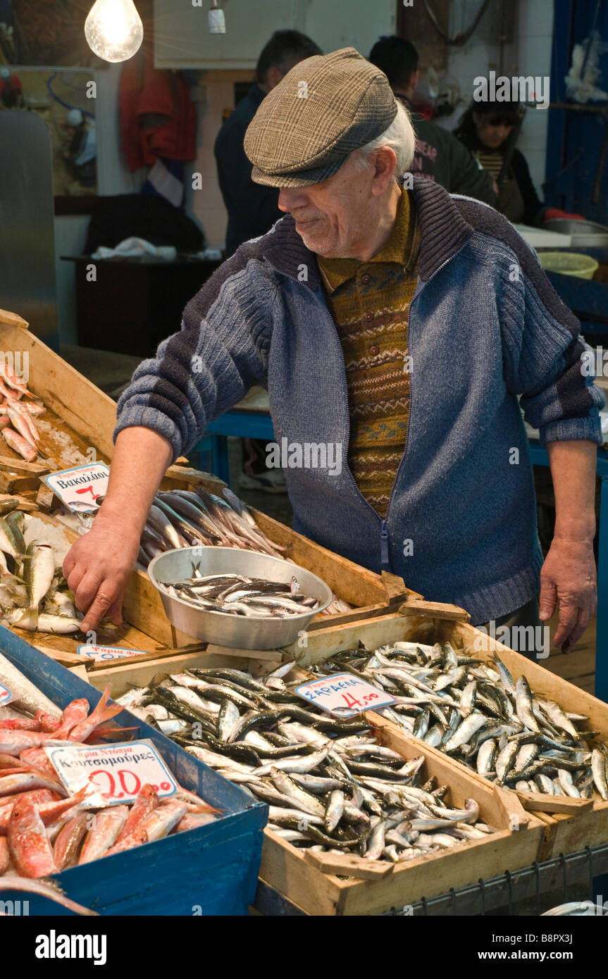 A fishmonger in the covered market in Kalamata Messinia Southern Peloponnese Greece - Stock Image