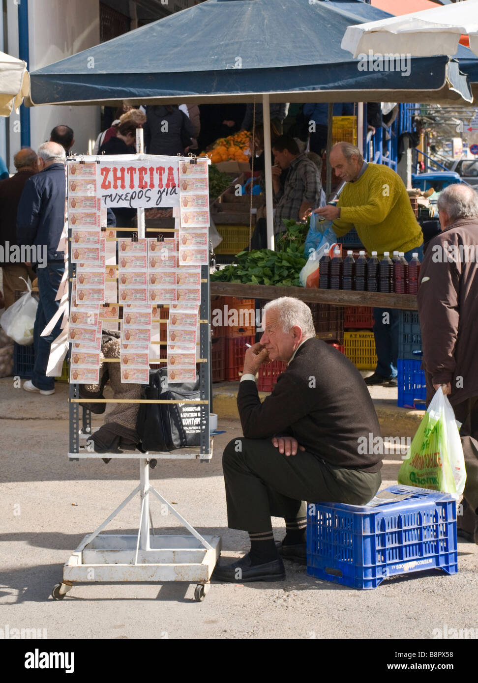 Selling lottery tickets outside the covered market in Kalamata Messinia Southern Peloponnese Greece - Stock Image