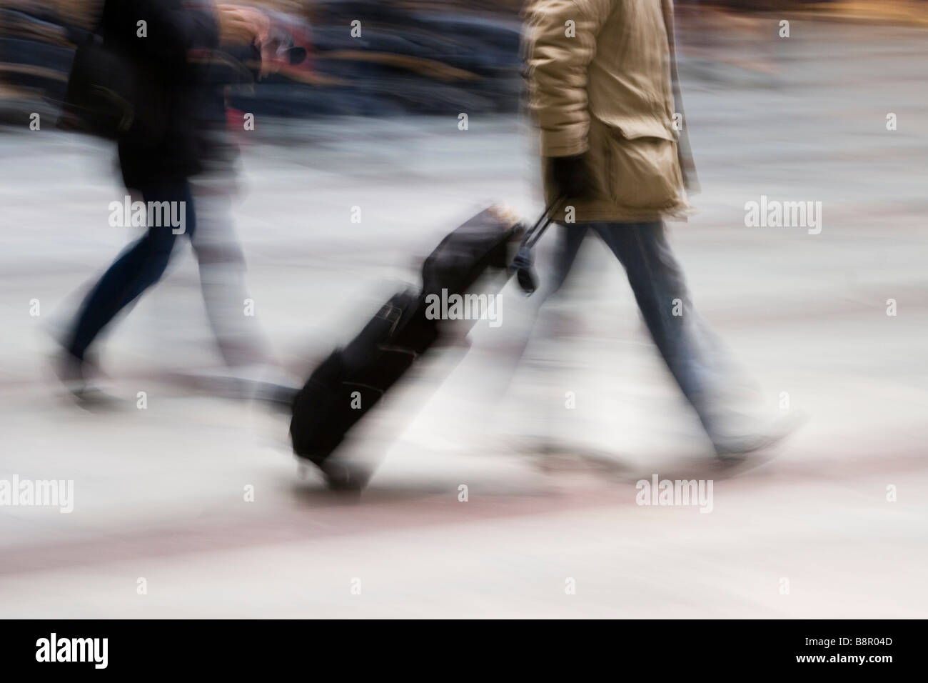 Traveller walking with a travellerbag. - Stock Image