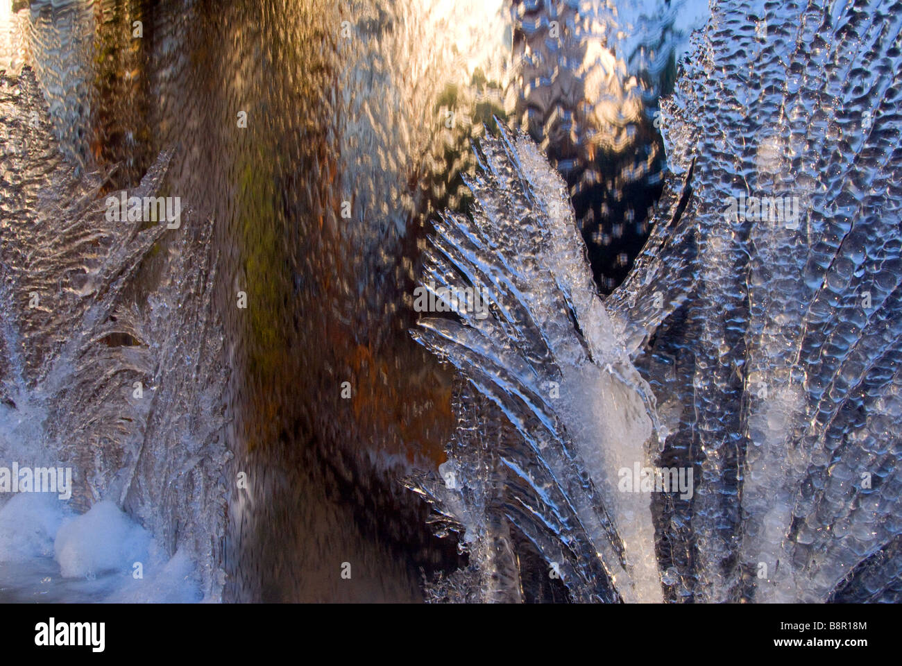 ice patterns on a steel fountain - Stock Image