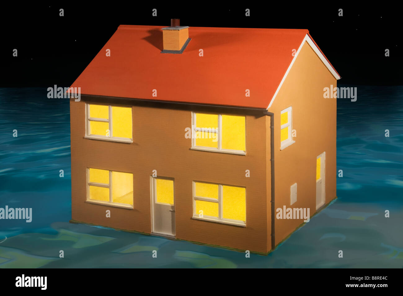 Lost Property ? A house surrounded by water or maybe afloat at night. - Stock Image