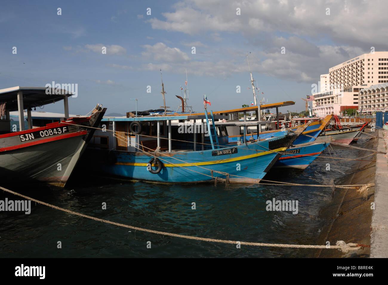 Fishing boats tied up infront of SAFMA fish market Kota Kinabalu Sabah Malaysia Borneo South est Asia - Stock Image