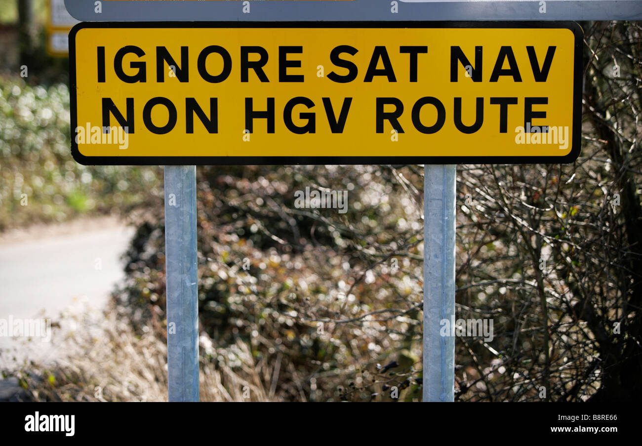 A road sign warning lorry drivers to ignore the directions their satellite navigation systems are giving them. - Stock Image