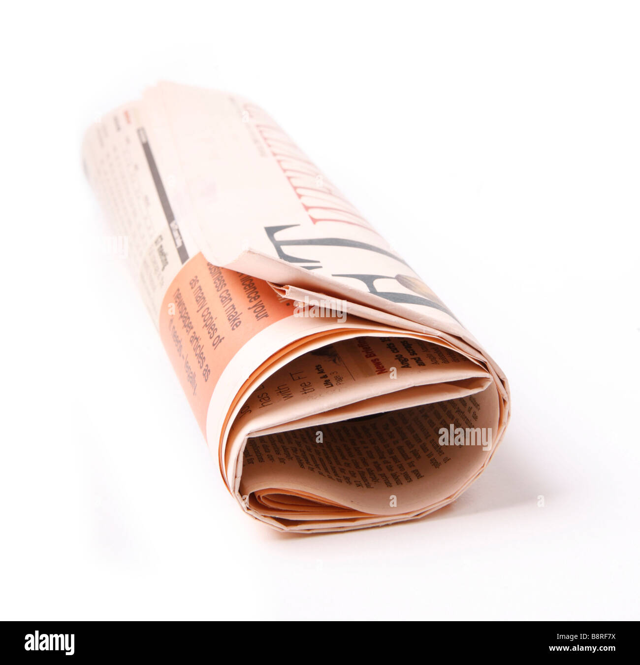 Rolled Up Newspaper Financial Times - Stock Image
