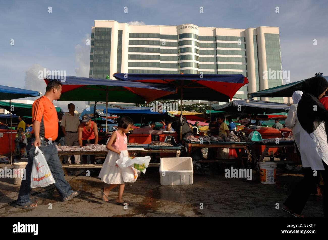 Customers and vendors selling and buying fish fish market waterfront Kota Kinabalu Sabah Malaysia Borneo South east - Stock Image