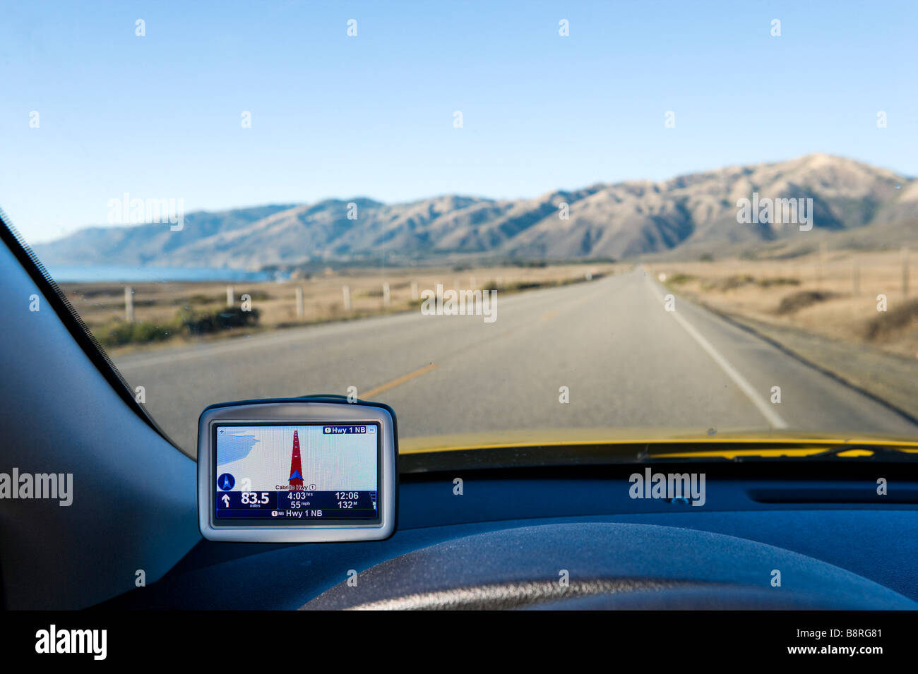 GPS Satellite Navigation in a car on Pacific Coast Highway (Cabrillo Highway) south of the Santa Lucia Mountains, - Stock Image
