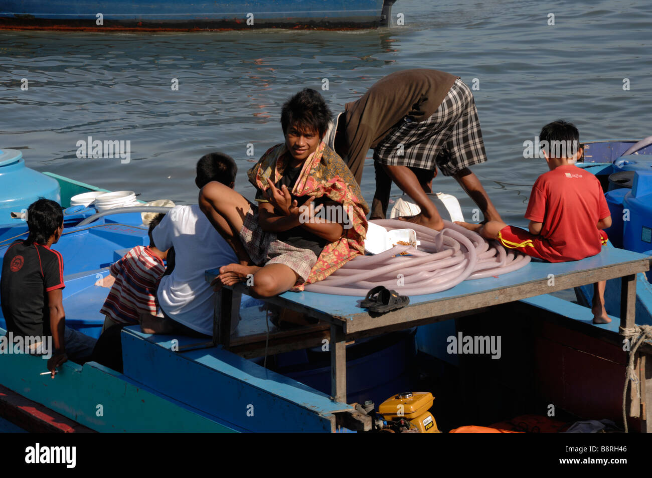 Boy on boat port Kota Kinabalu Sabah Malyasia Borneo South east Asia - Stock Image