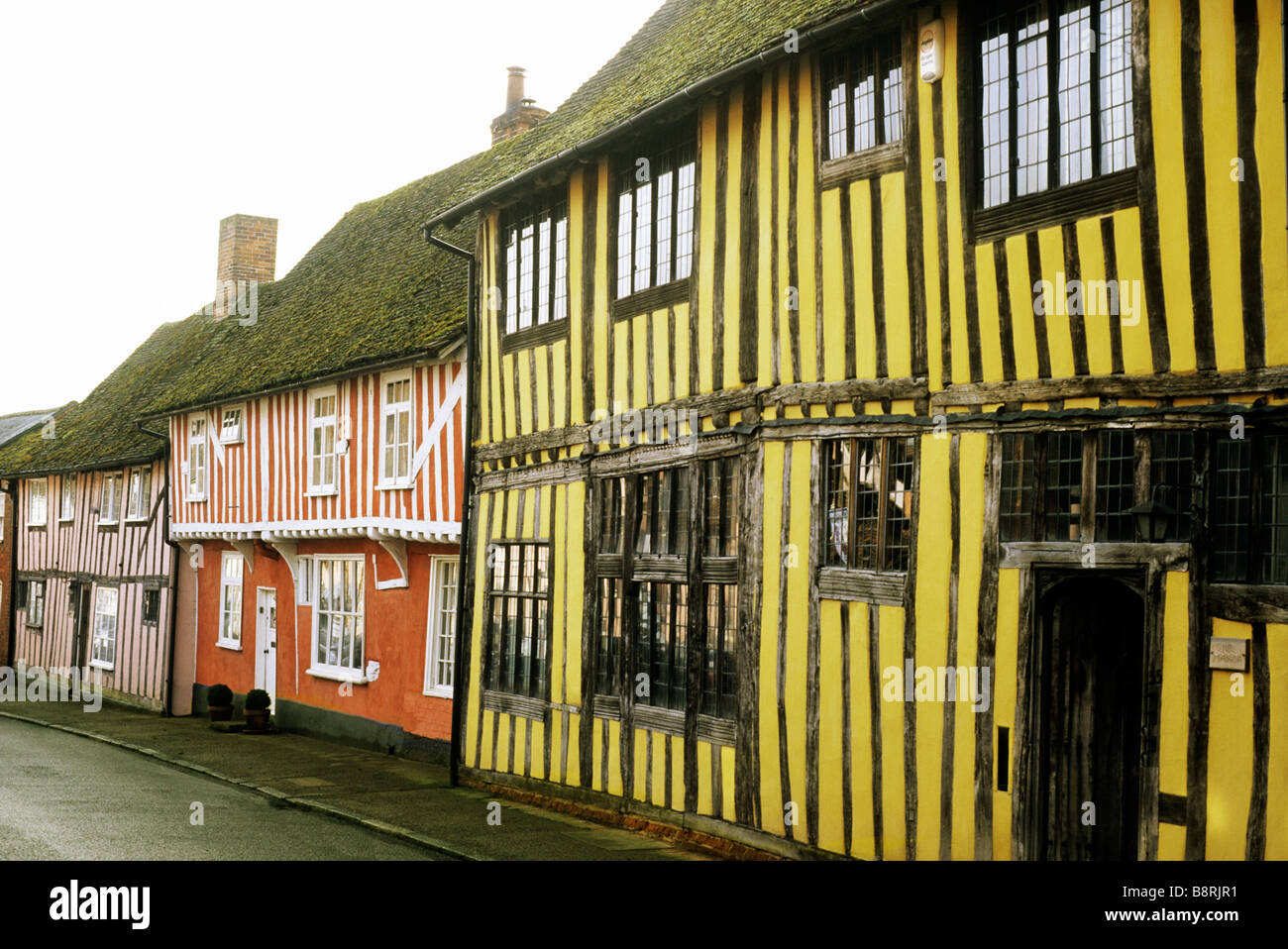 Colour washed timbered houses house Lavenham Suffolk water street Tudor listed buildings wool town English medieval - Stock Image