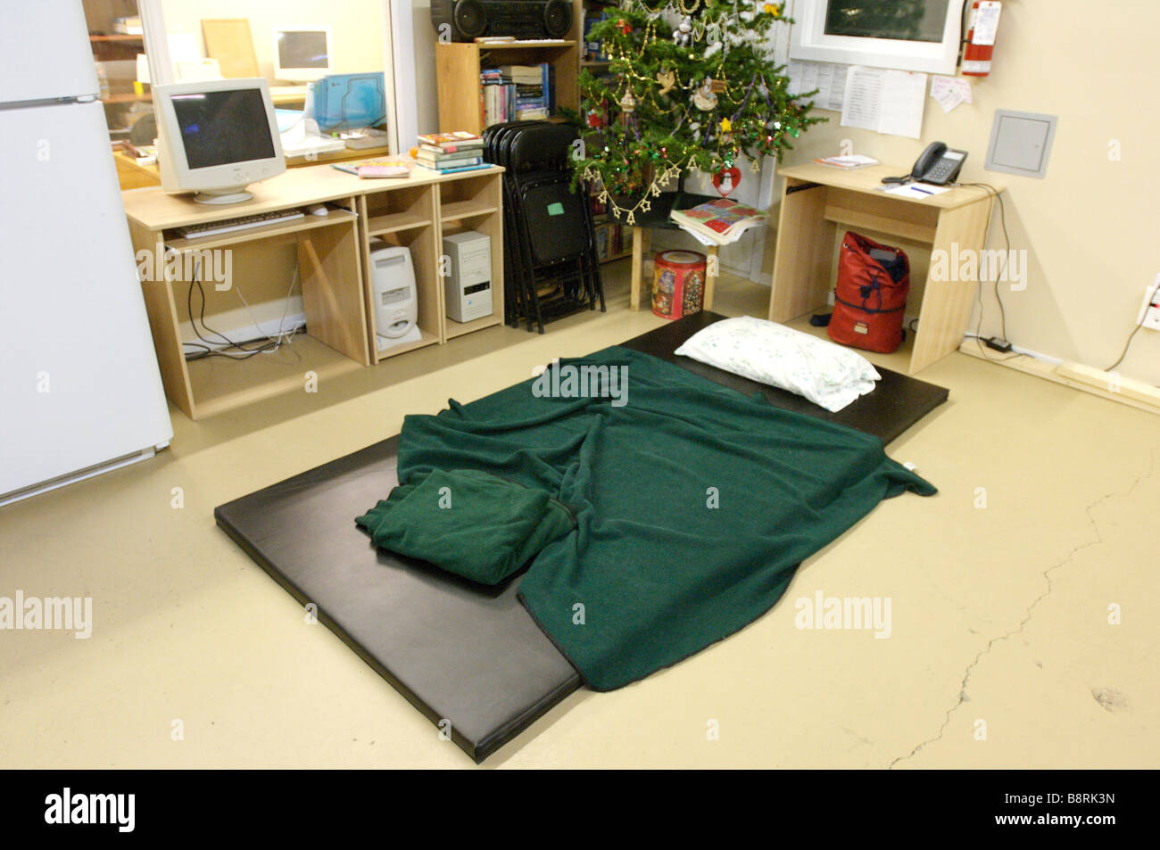 Bed at a homeless shelter.  a mattress on a floor serves as a bed at homeless shelter.  Squamish BC, Canada.  Temporary - Stock Image
