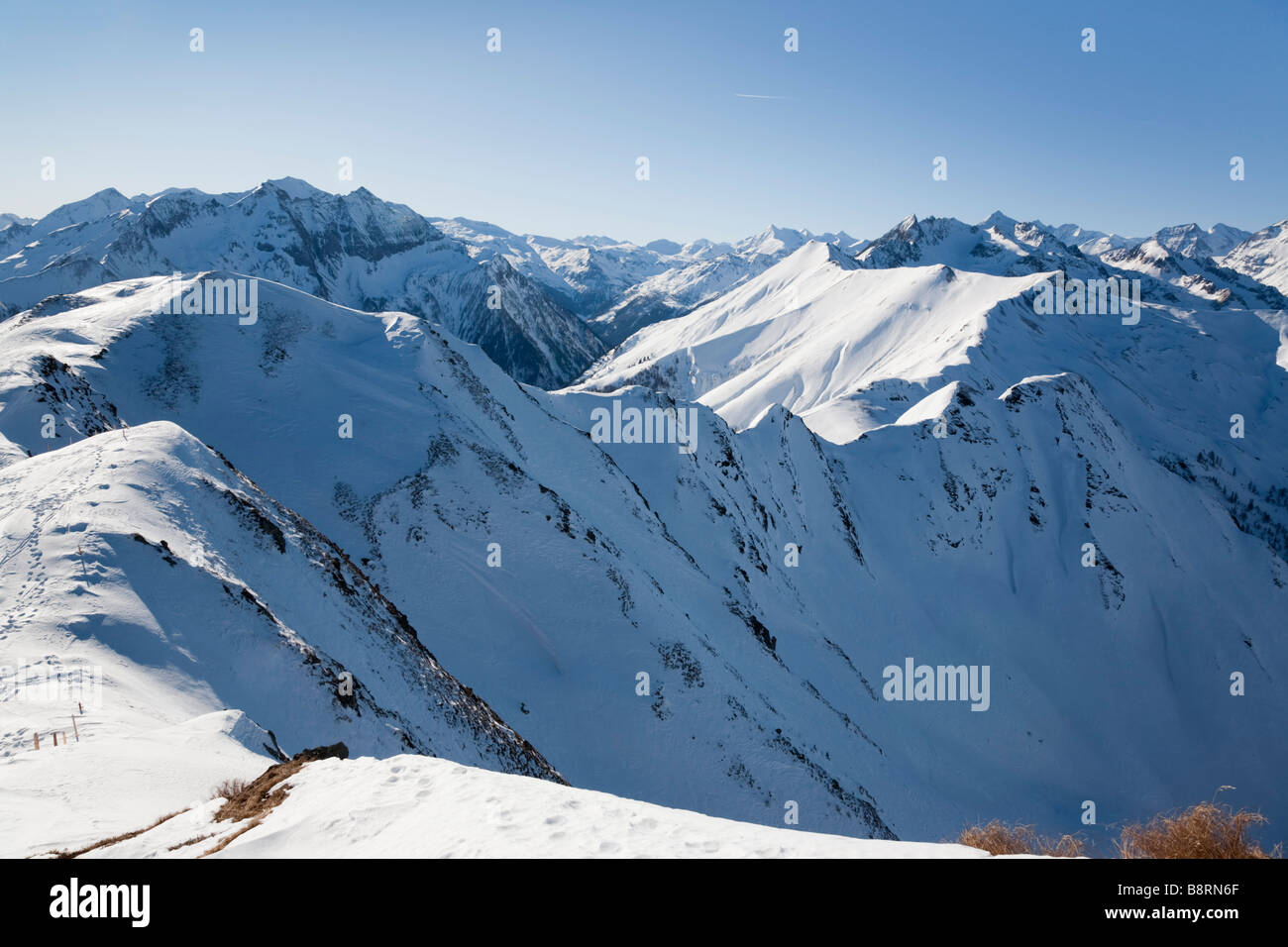 Austrian Alps in National Park Hohe Tauern with snow covered mountains from Schwarzwand mountain summit in winter. Stock Photo