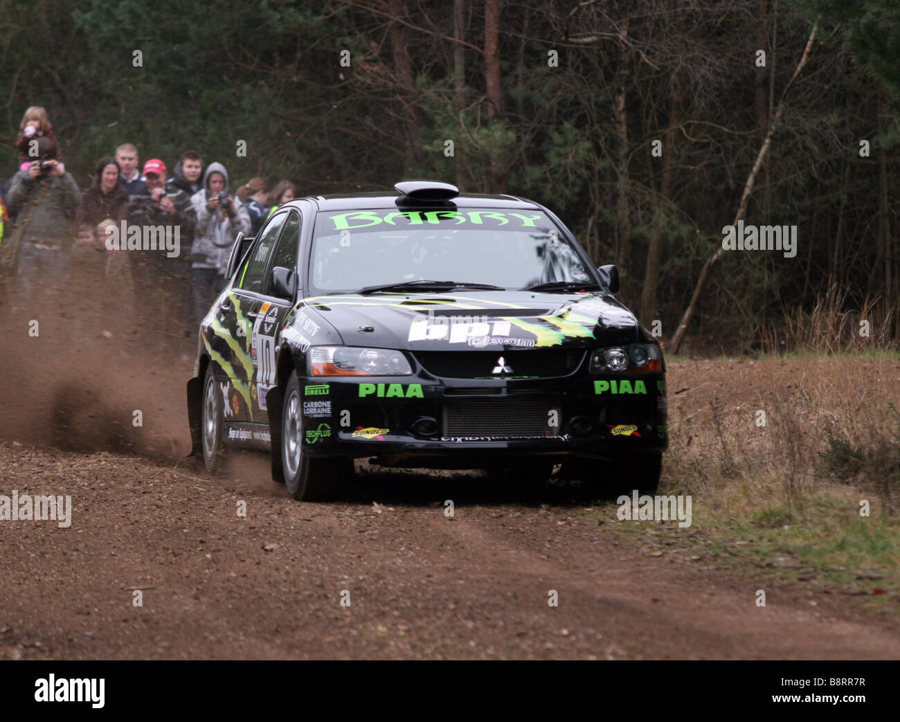 Action shot of rally car preforming at Rallye Sunseeker 2009 - Stock Image
