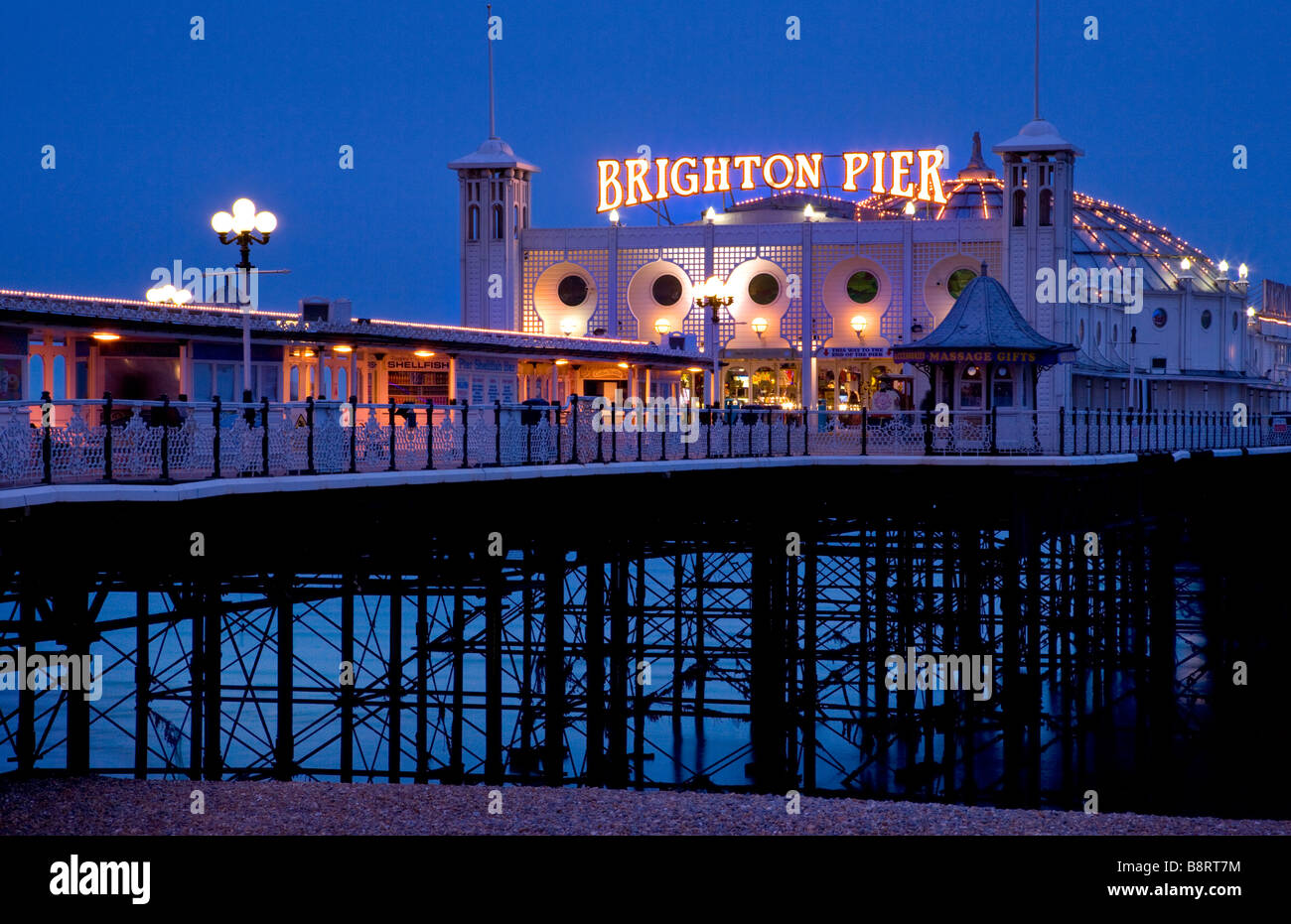 Palace Pier at night, Brighton, East Sussex, England. - Stock Image