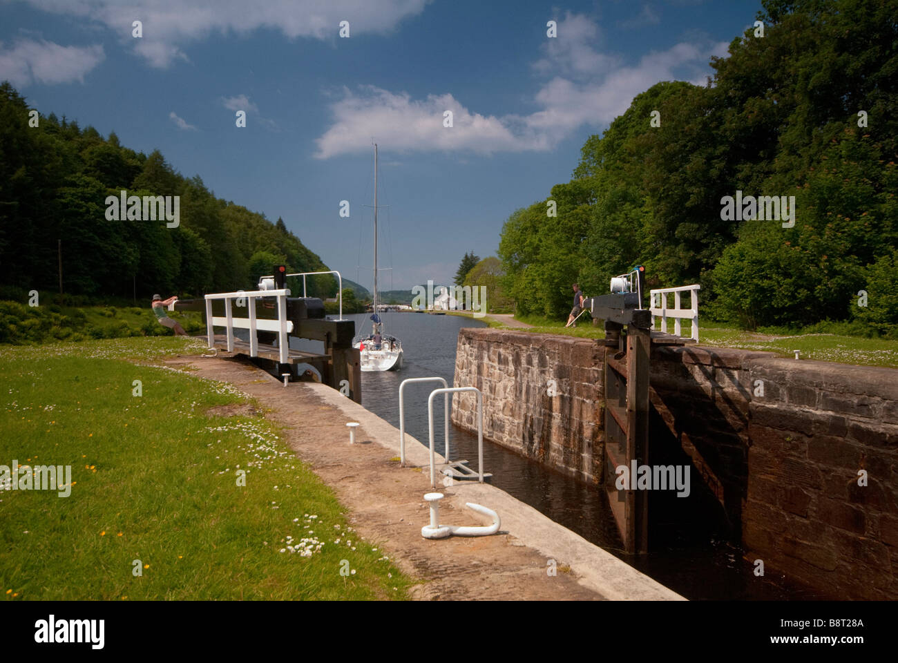 A lock gate being closed on the Crinan Canal, West of Scotland, in the U.K. - Stock Image