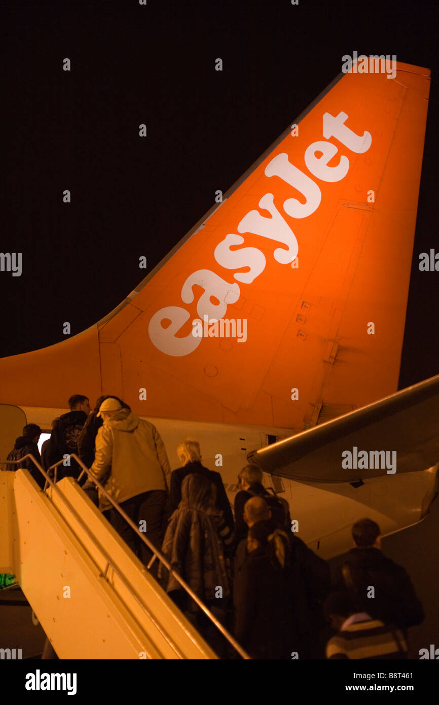 Passengers boarding an Easyjet plane going from Schoenefeld Airport in Berlin to London's Luton Airport. - Stock Image