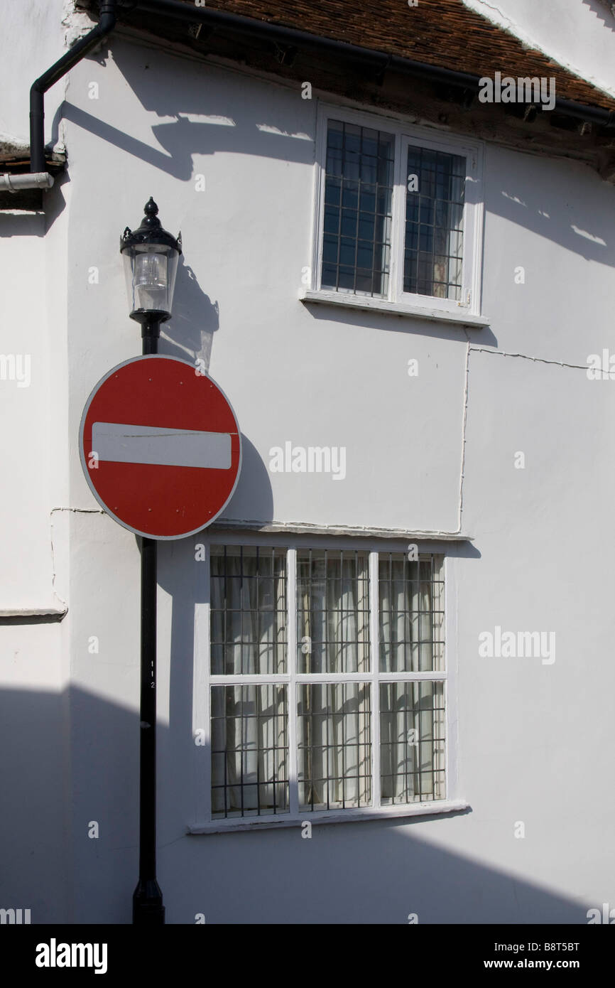 red no entry sign post lavenham pretty historic picturesque village suffolk east anglia england uk gb Stock Photo