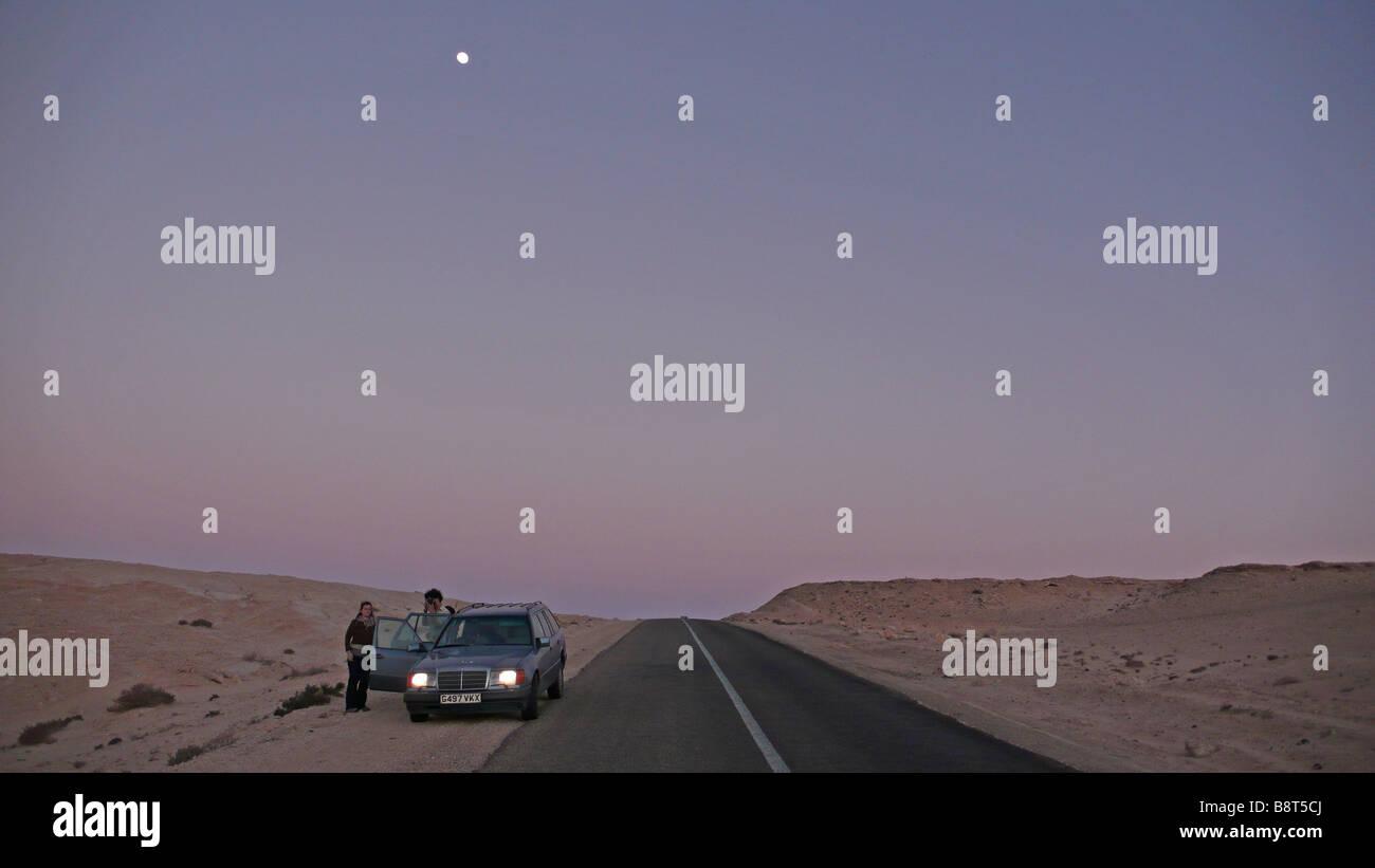 Desert road at dusk - Stock Image