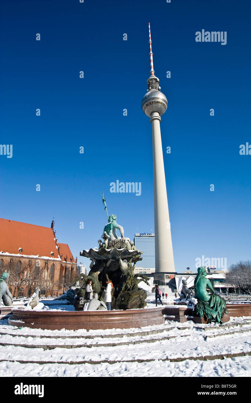 snow at Neptun fountain in front of Alex in Berlin center - Stock Image