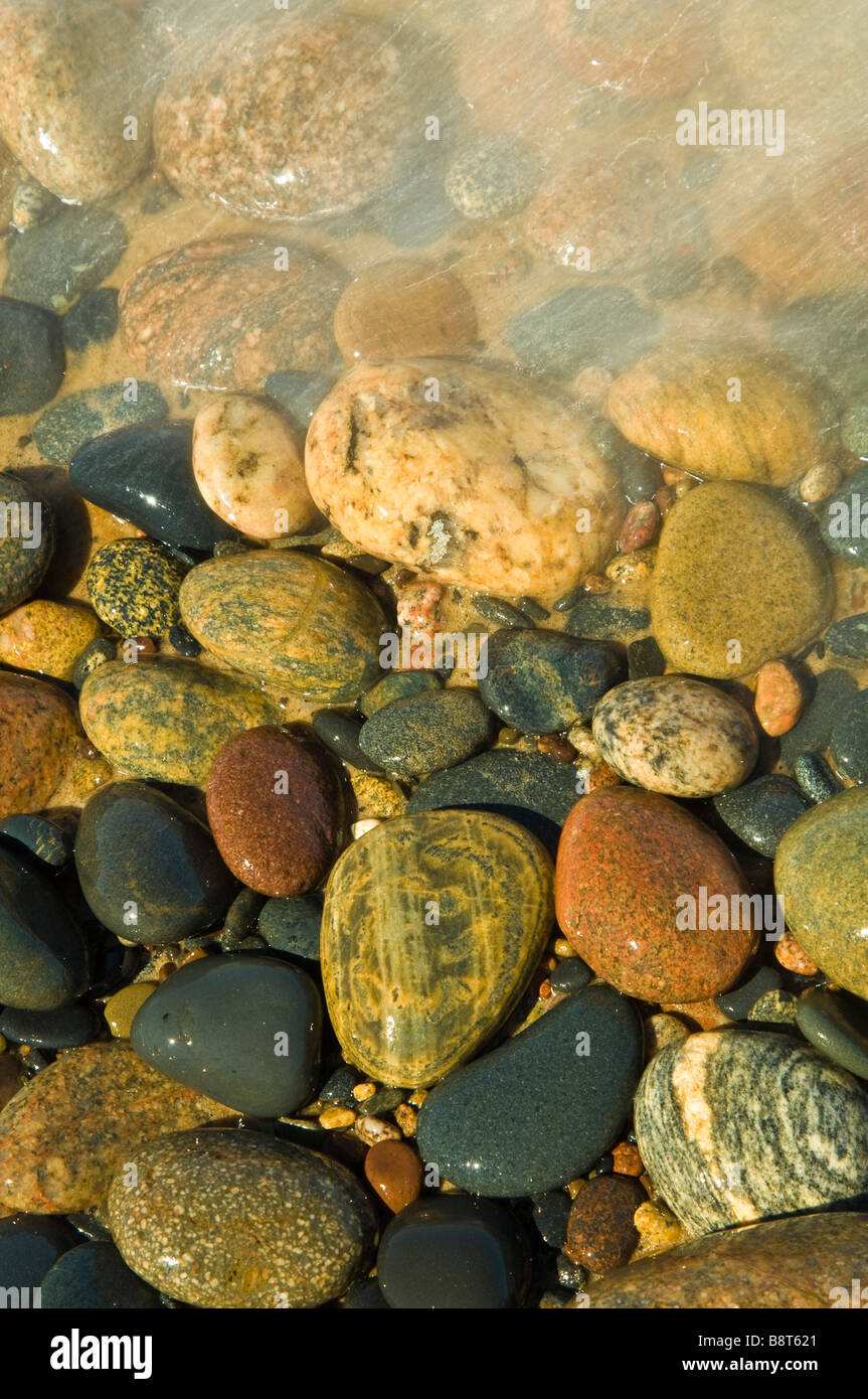 Colorful beach rocks on a Great Lakes shoreline in Northern Michigan, USA - Stock Image
