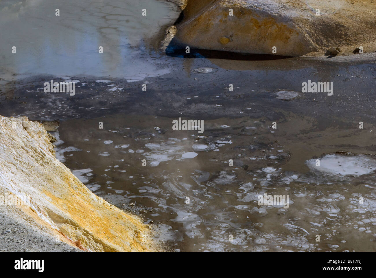 pyrite cristals on surface of Pyrite Pool boiling spring in Bumpass Hell area at Lassen Volcanic National Park California - Stock Image