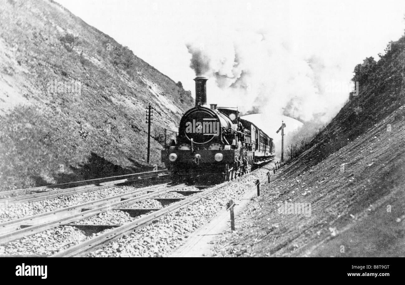 GWR Iron Duke 1890 photo of the 5 2 2 locomotive hauling an express train on a mixed gauge track Stock Photo