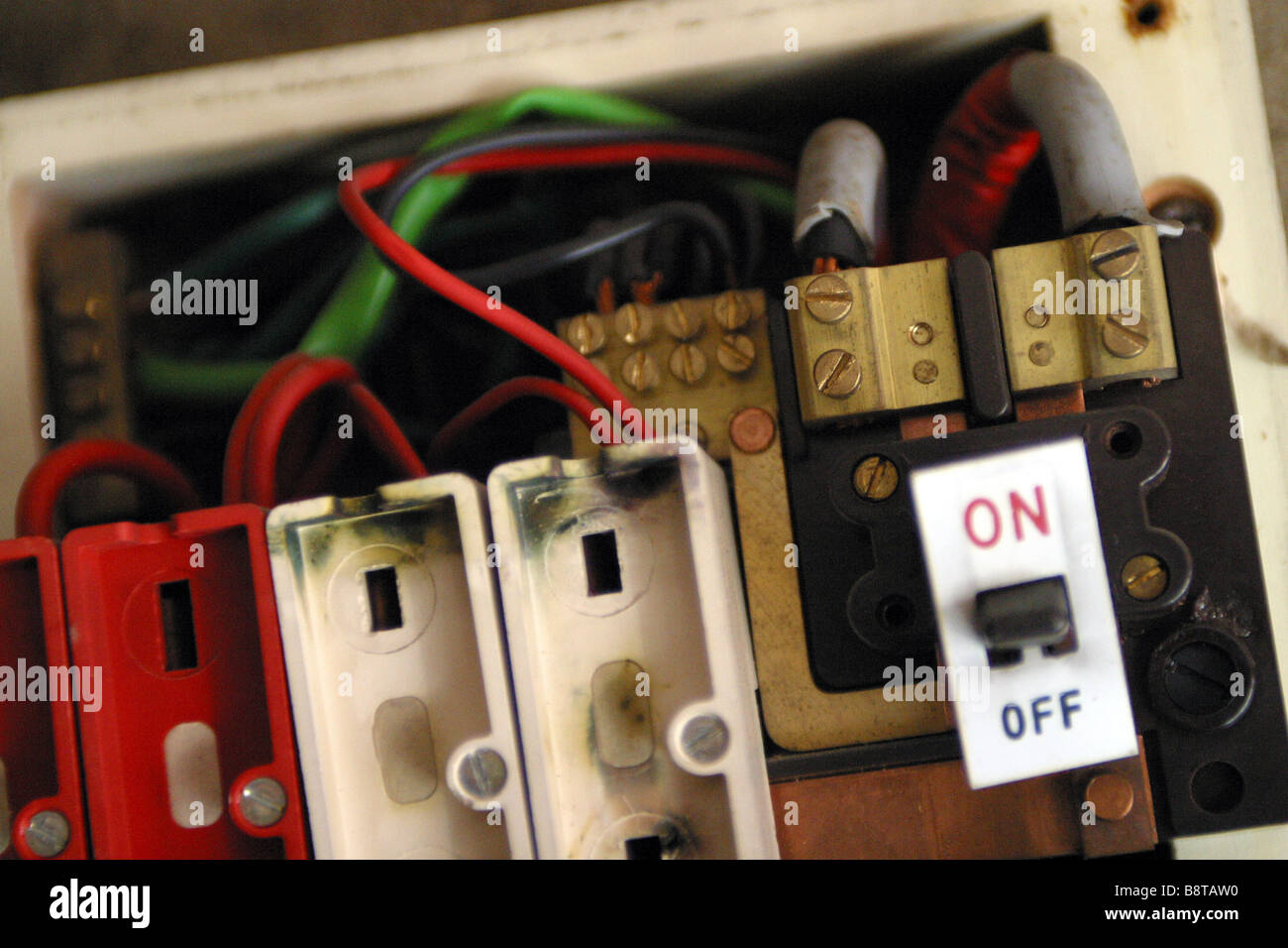 consumer unit box electrical fuse box old wire fuse type in a 1970's house  - Stock