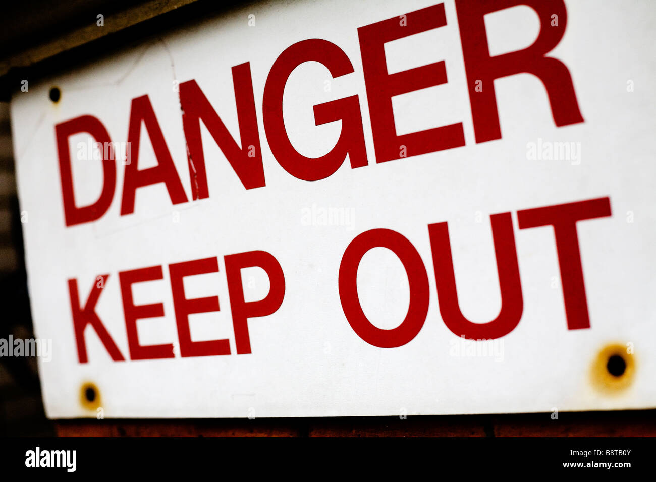 A Danger Keep Out sign. - Stock Image