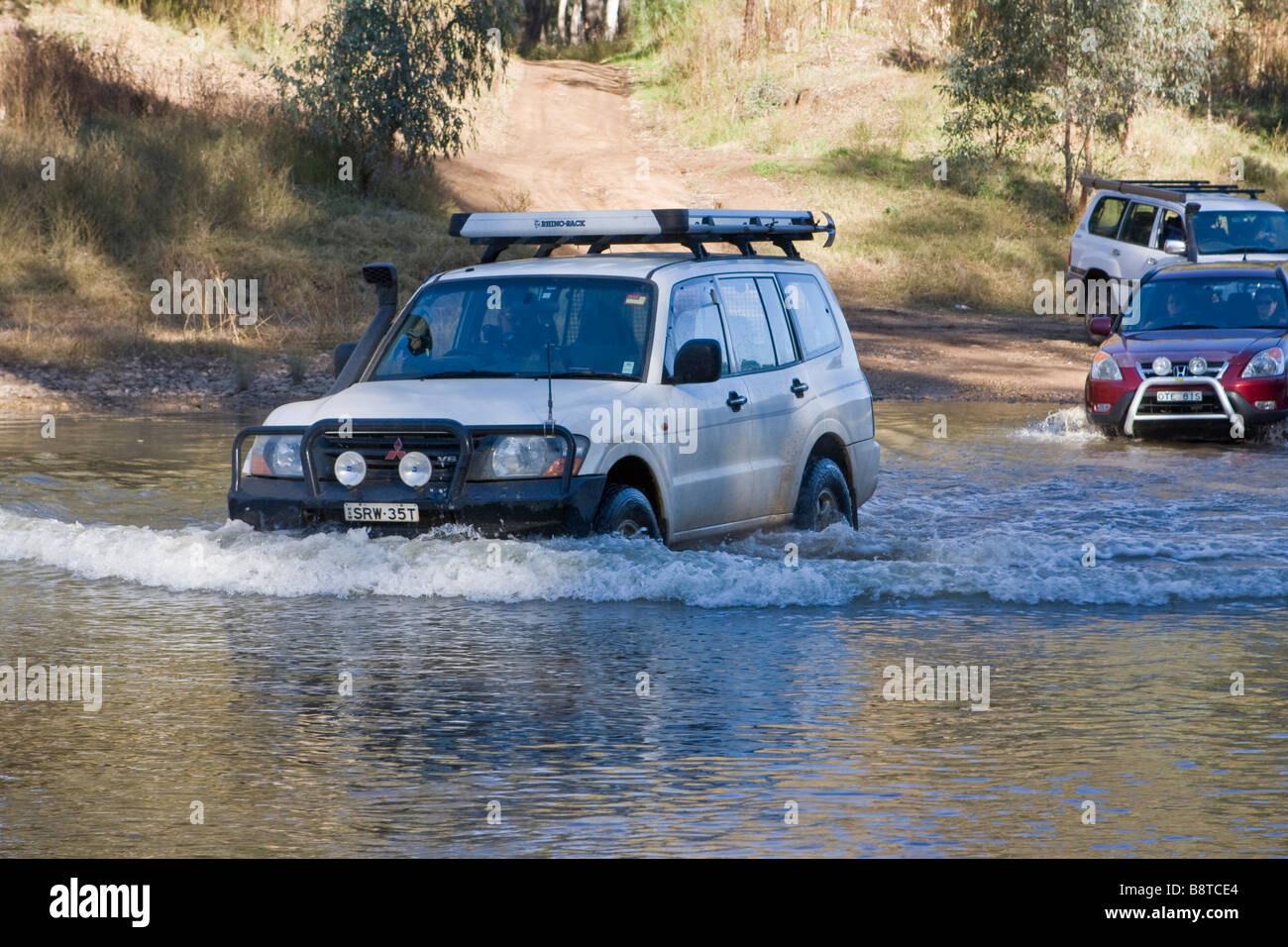 A Pajero leads the way across the Macquarie River near Dubbo in Central New South Wales Stock Photo