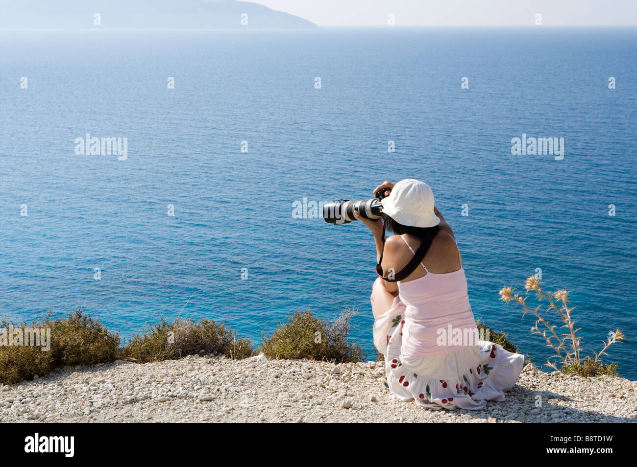 Lady photographer at Mirtos beach, Kefalonia, Greece, Europe - Stock Image