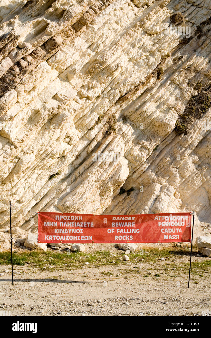Rock strata and warning sign - Mirtos beach, Kefalonia, Greece Europe - Stock Image