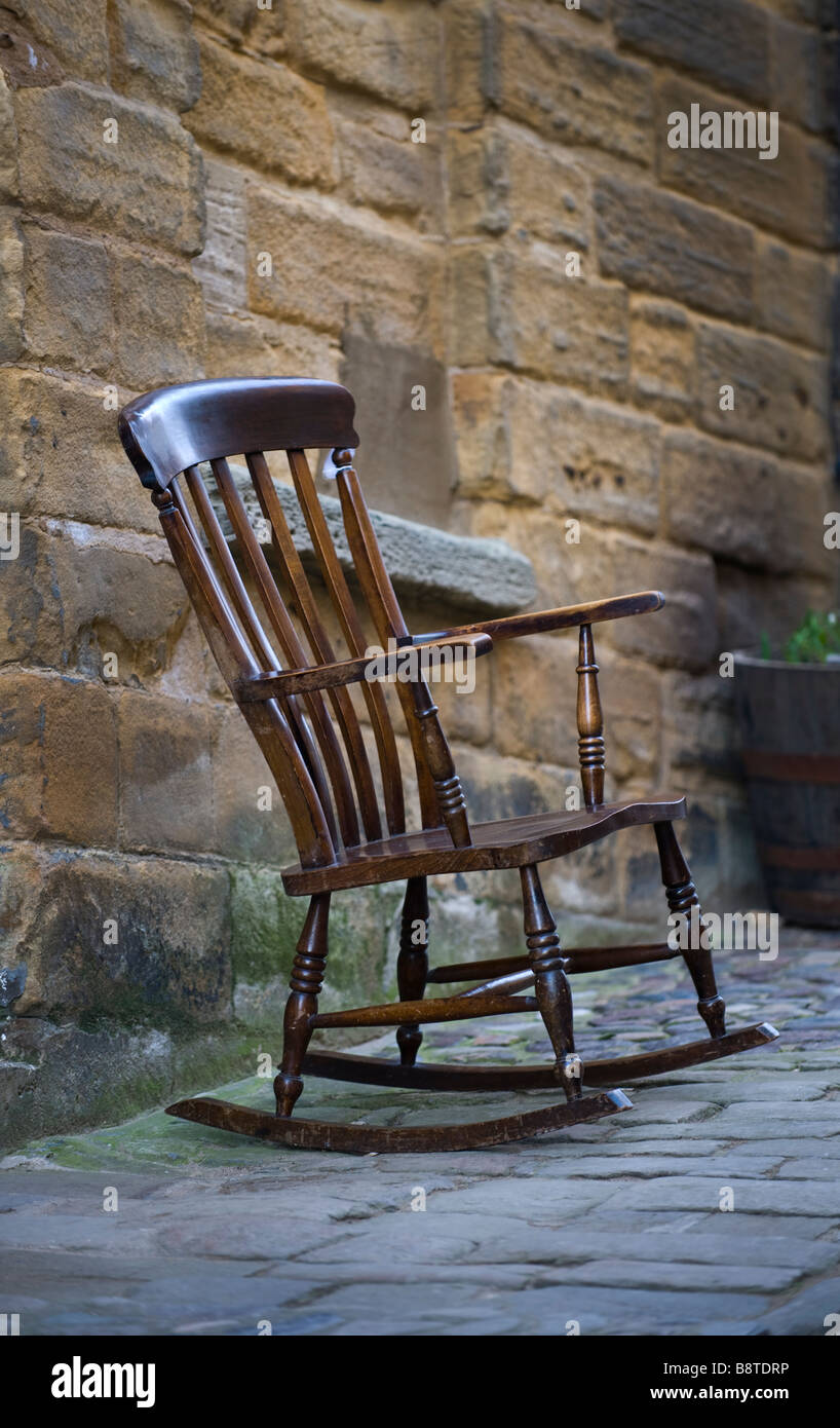 Old Wooden Rocking Chair Outside On The Pavement